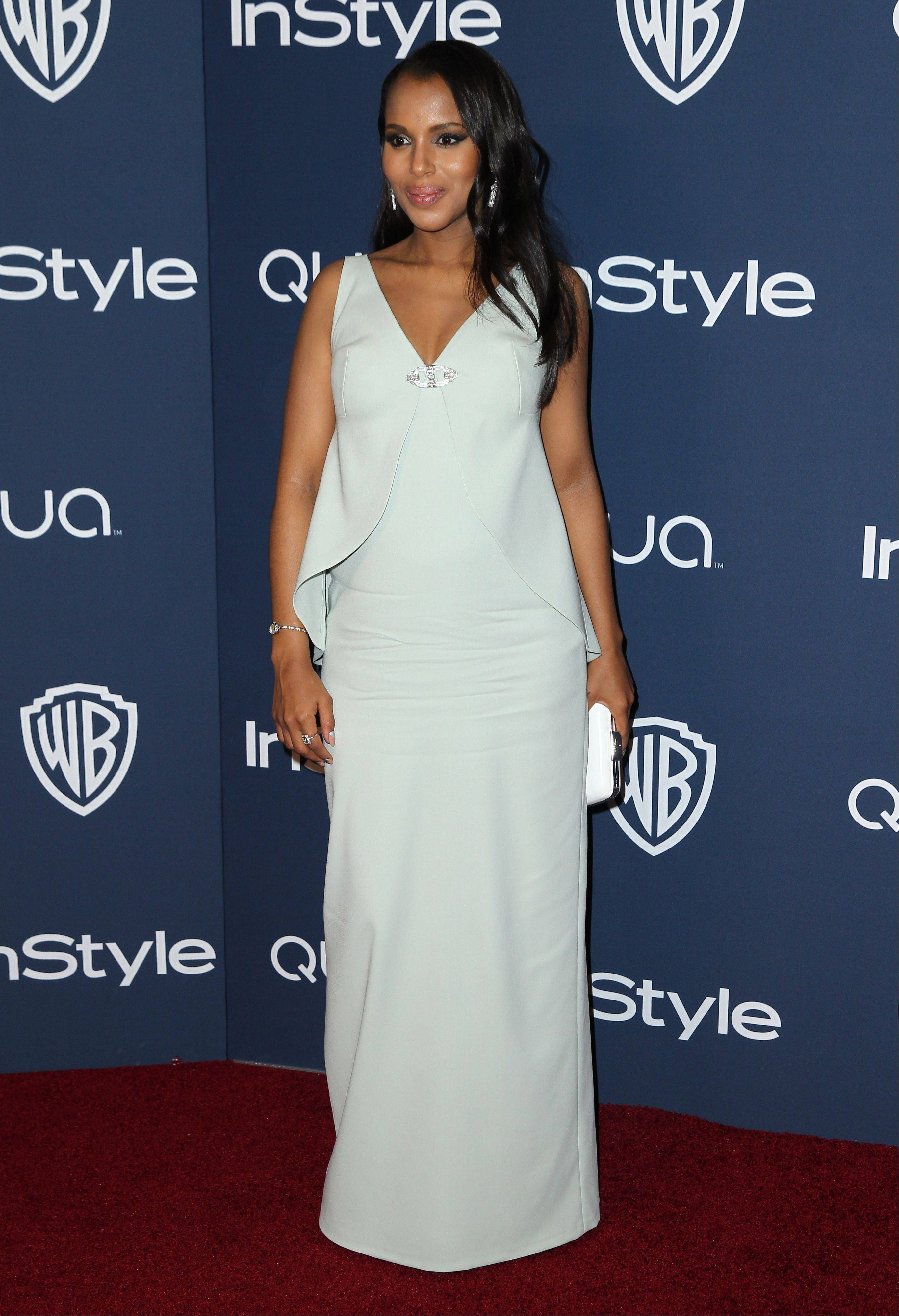 Kerry Washington earned raves for her sleeveless white gown with a low neck and jacket-like top from Balenciaga.