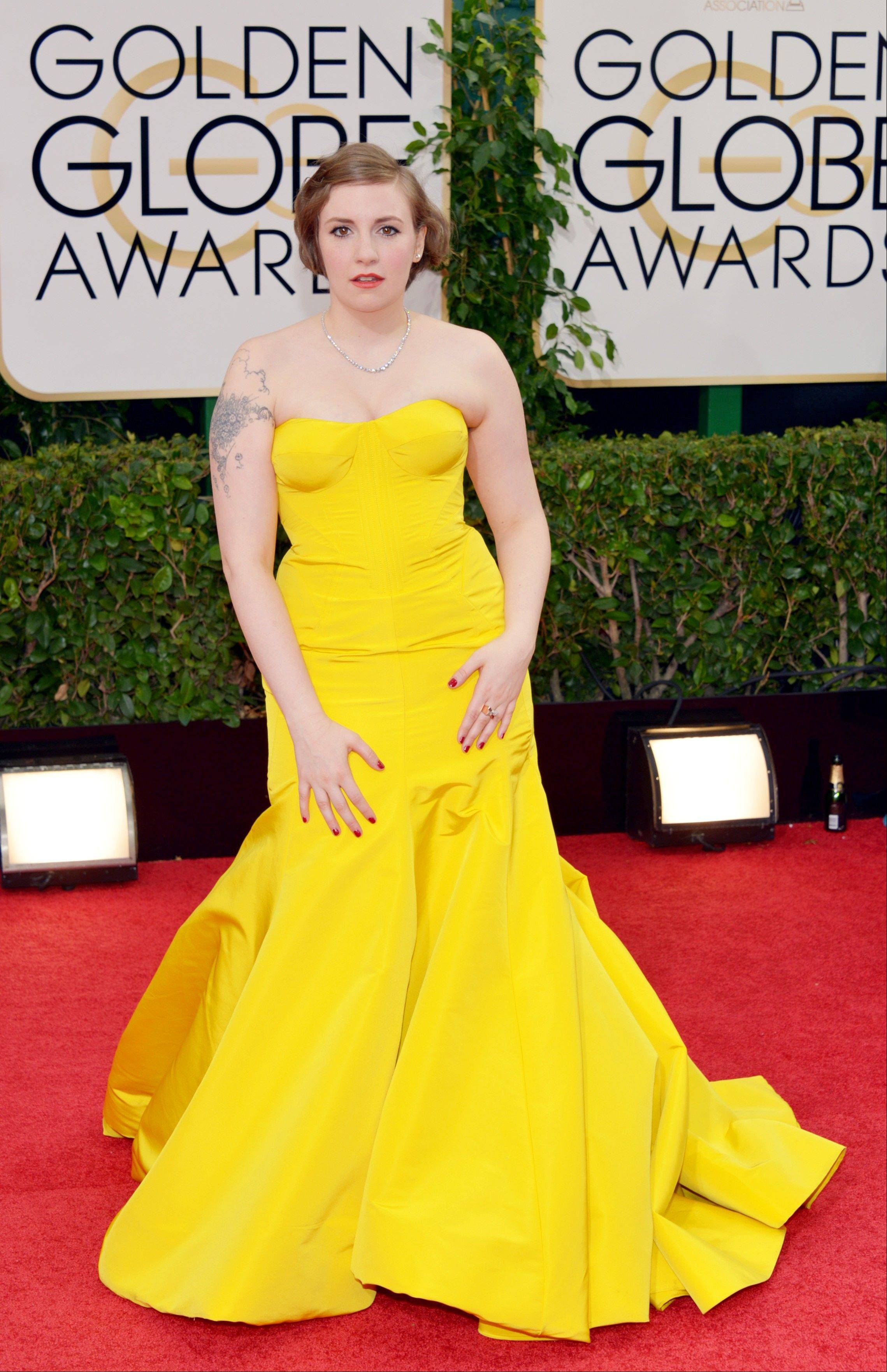 Lena Dunham got everyone's attention at the Golden Globes in a bright yellow Zac Posen dress.