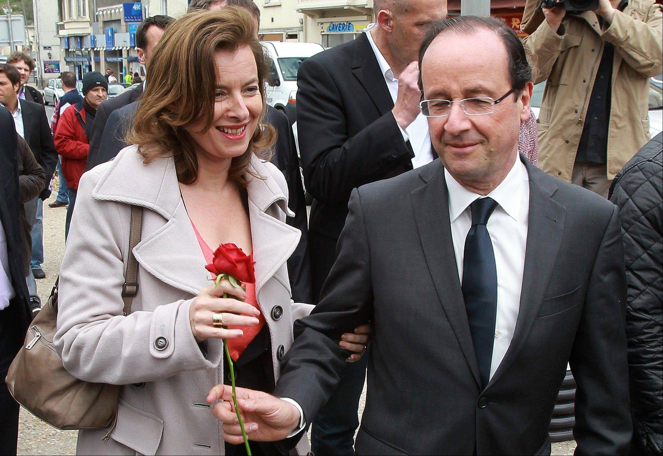 French President Francois Hollande offers a rose to his companion Valerie Trierweiler back in May 2012. The woman considered France's first lady was hospitalized after a report that Hollande is having an affair with an actress, her office said Sunday.
