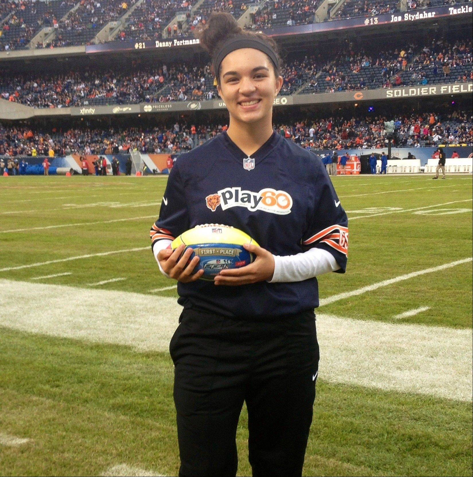 Weeks of preparation paid off this weekend for Alisa Fallon of Des Plaines, who won her age group in the NFL's Punt, Pass and Kick contest in Denver. Alisa, shown here at Soldier Field, was honored Sunday before a national television audience during the Denver Broncos playoff game.