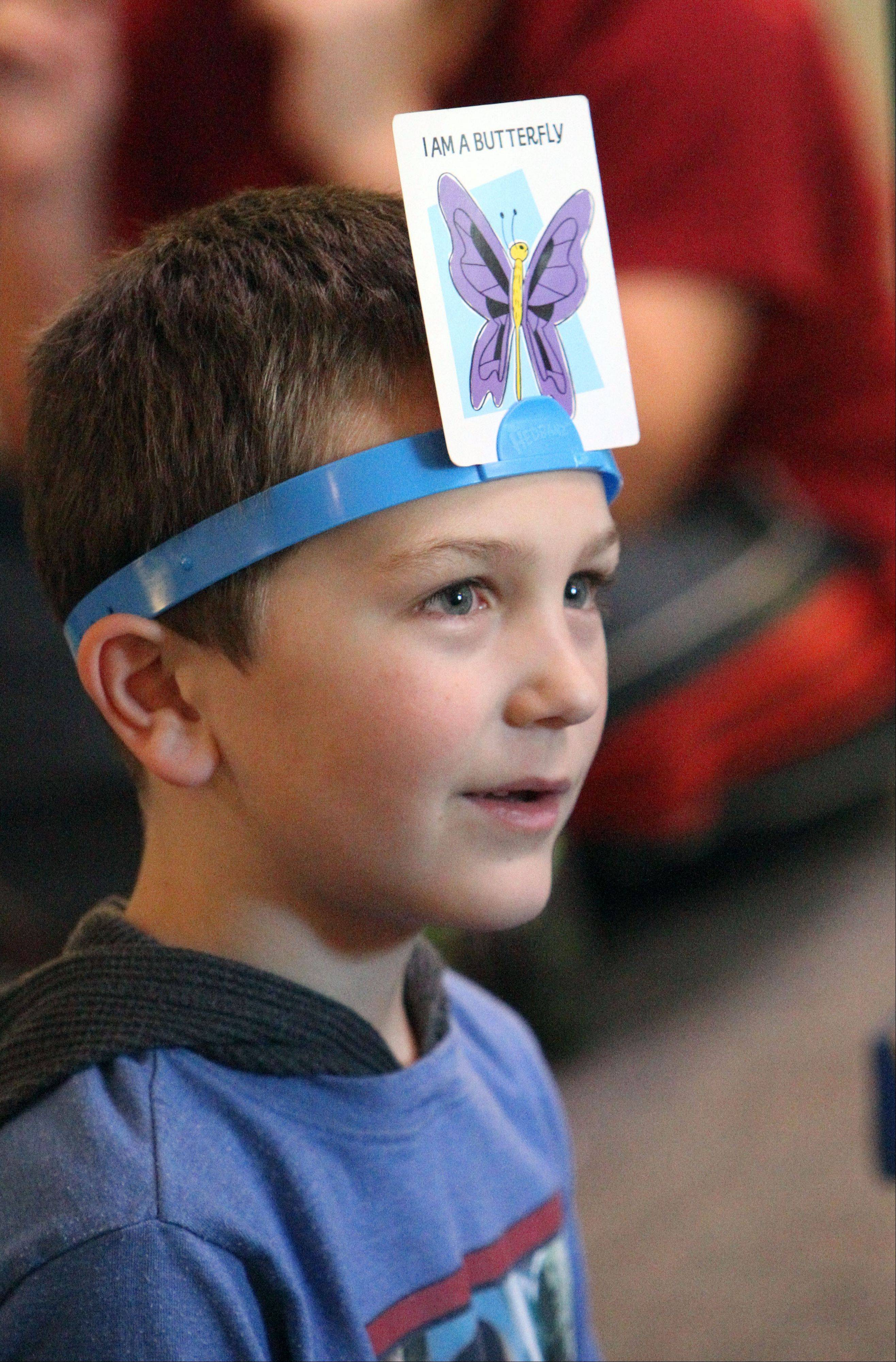 "Brayden Brafford, 8, of Libertyville plays ""Head Bandz"" on Monday during an after-school program called Games Galore at Rockland Elementary School in Libertyville."