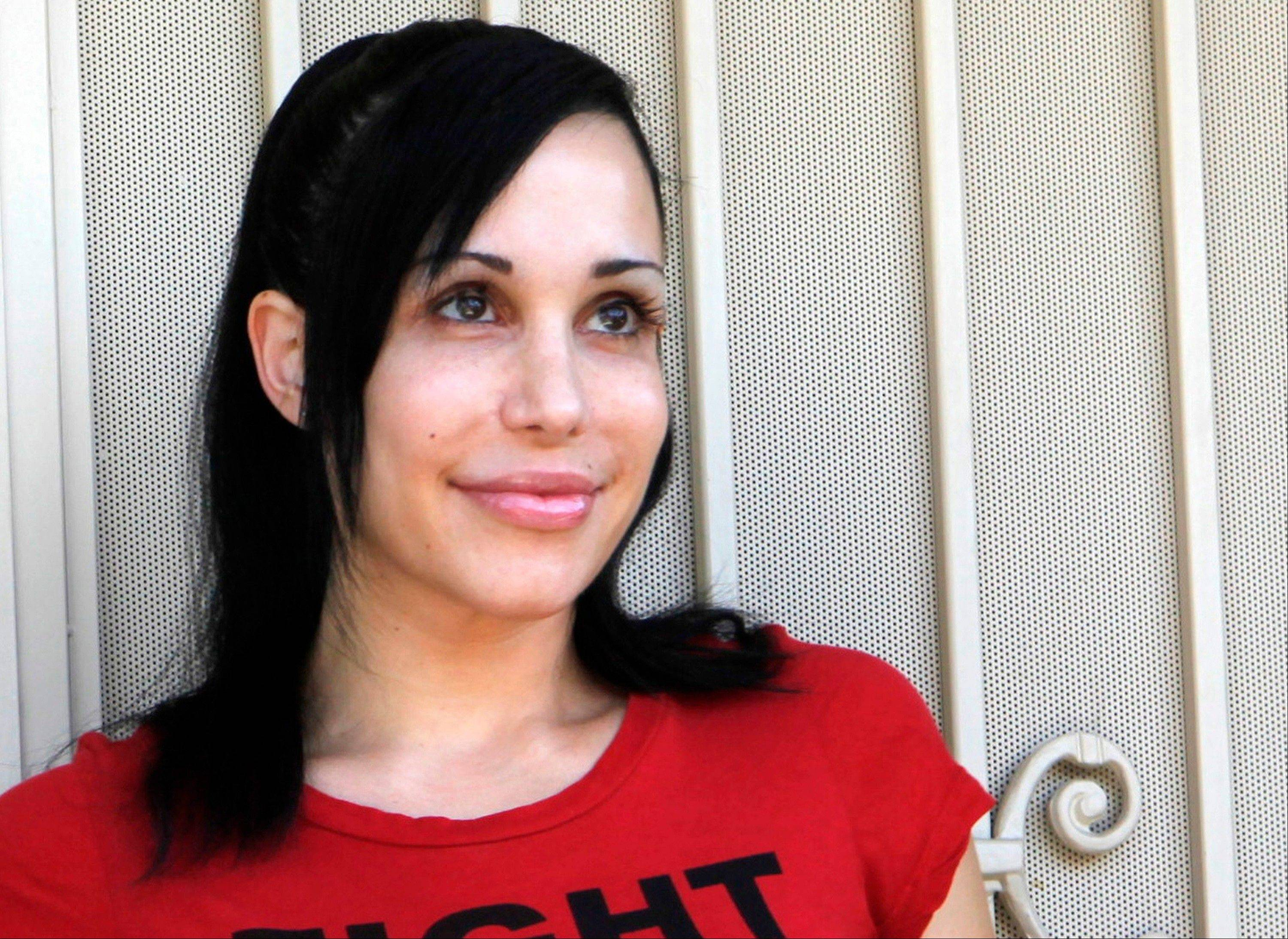 "Nadya Suleman, better known as ""Octomom,"" stands outside her home in La Habra, Calif."