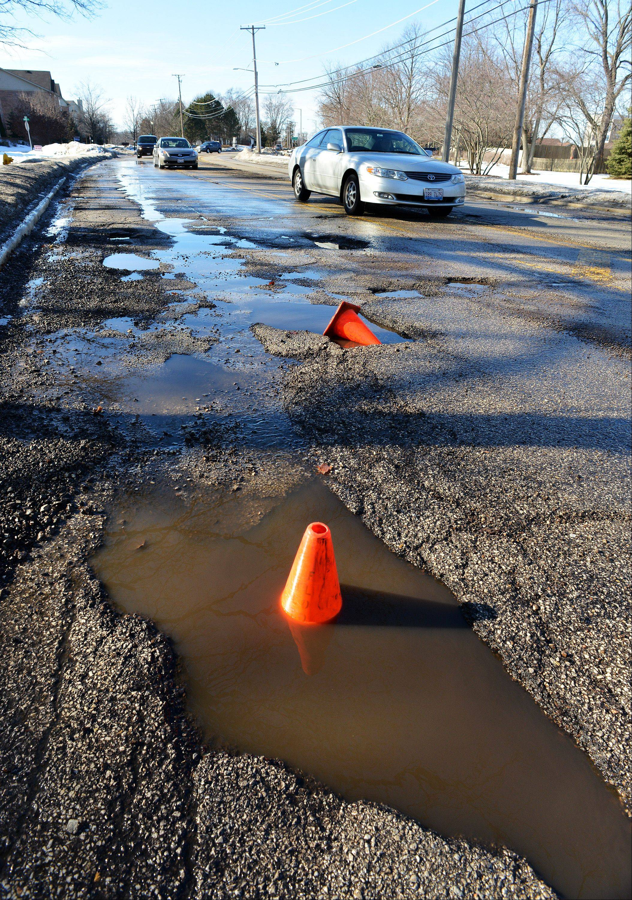 Is it a pothole or just a puddle? Many potholes in Winfield are filled with water so it is hard to tell. These water-filled potholes on Jewell Road near Central DuPage Hospital are so bad they have warning cones to alert drivers, many of which were crossing over into oncoming traffic to get around them.