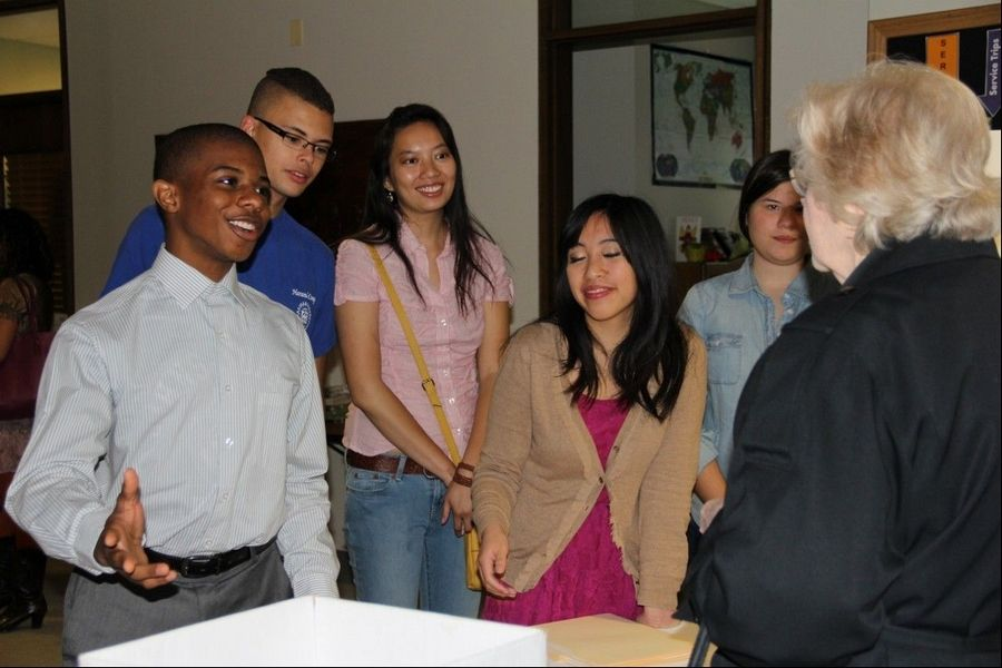 Paul Lewis, left, helps explain EYEsee's mission during a presentation at Northwestern University's Sheil Catholic Center. Founder, Janice Guzon, is front right, with fellow leaders Tristan Blus of North Barrington, back left, Tricia Aguilar of Des Plaines and Amy Sonnicksen of Hoffman Estates, back right.