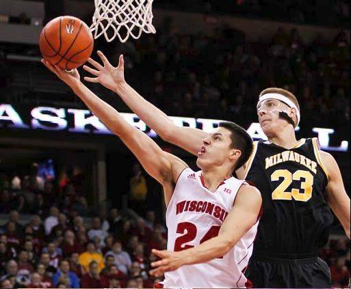 Wisconsin freshman Bronson Koenig, left, shoots past Milwaukee's J.J. Panoske during the second half of a Dec. 11 game in Madison.