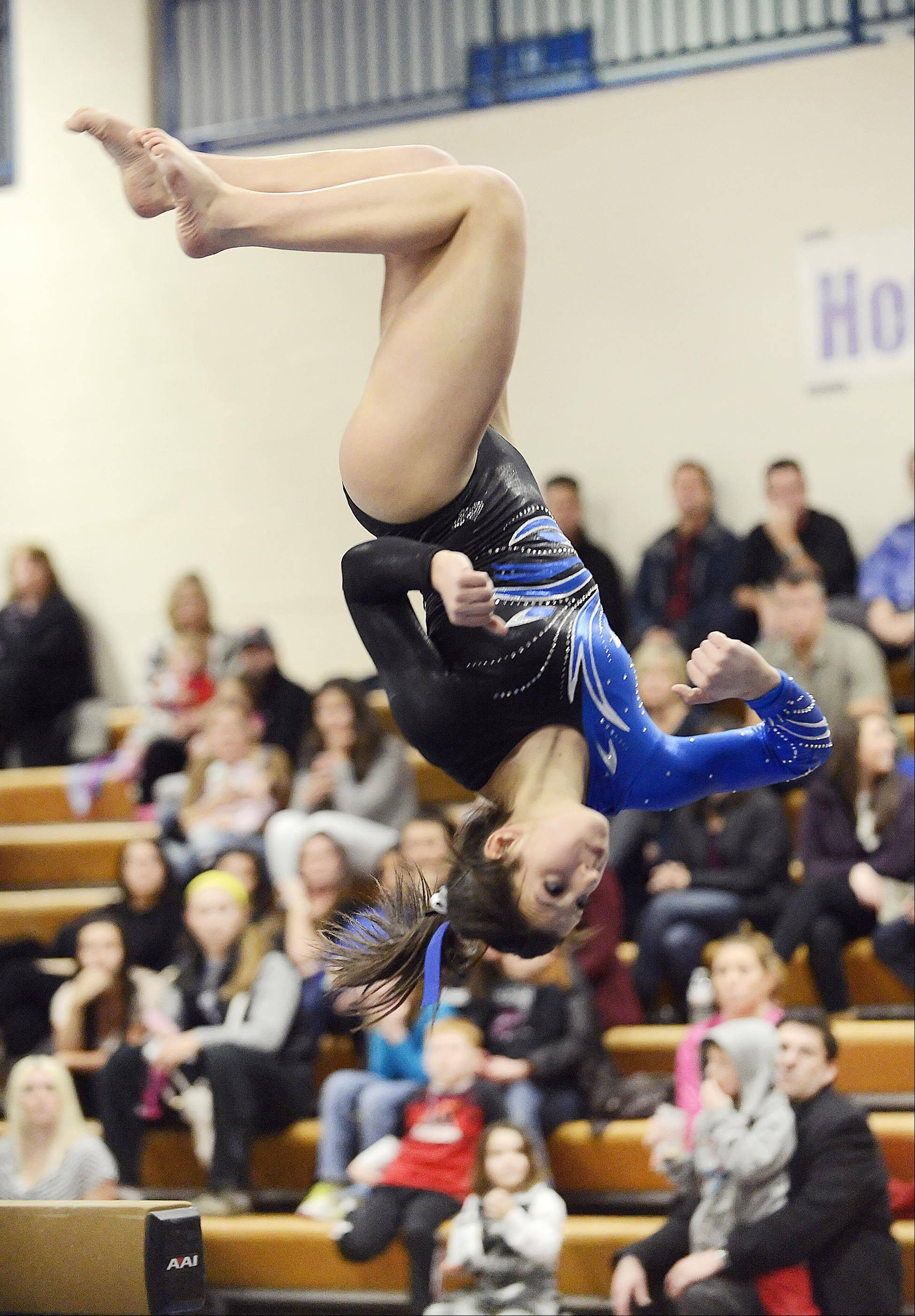 Geneva's Grace Ginsberg competes on the balance beam against St. Charles co-op Monday in Geneva.