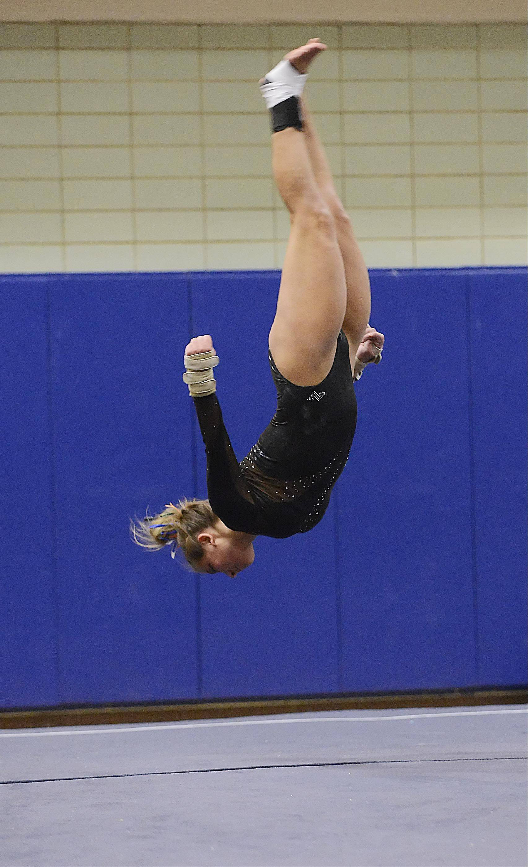 St. Charles co-op's Kelly Gorniak competes against Geneva in the floor exercise Monday in Geneva.