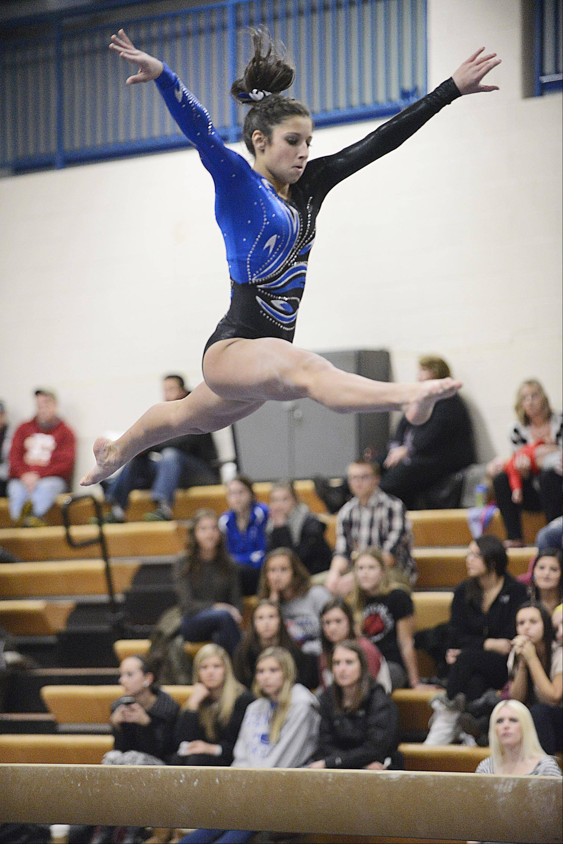 Geneva's Claire Ginsberg competes against St. Charles co-op on the balance beam Monday in Geneva.