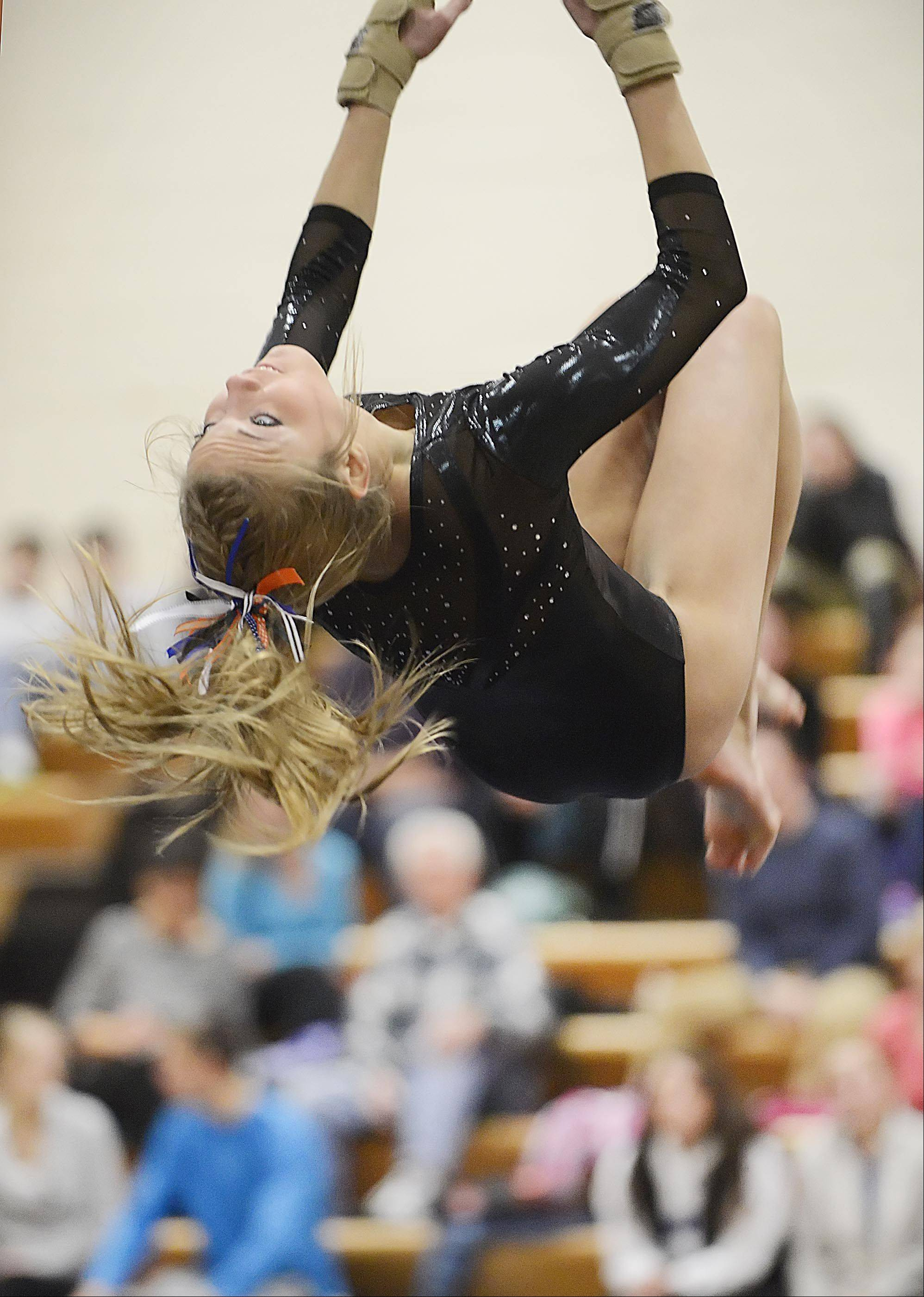 St. Charles co-op's Sidney Copeland competes against Geneva on the floor exercise Monday in Geneva.