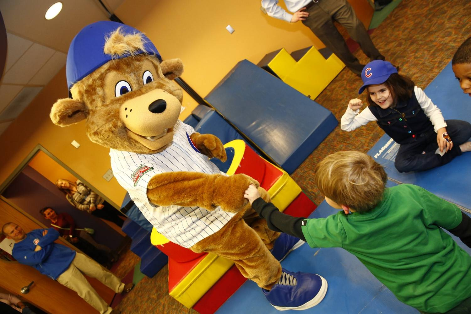 The Cubs' new mascot, Clark the Cub visits Monday night with kids at Advocate Illinois Masonic's Pediatric Development Center.