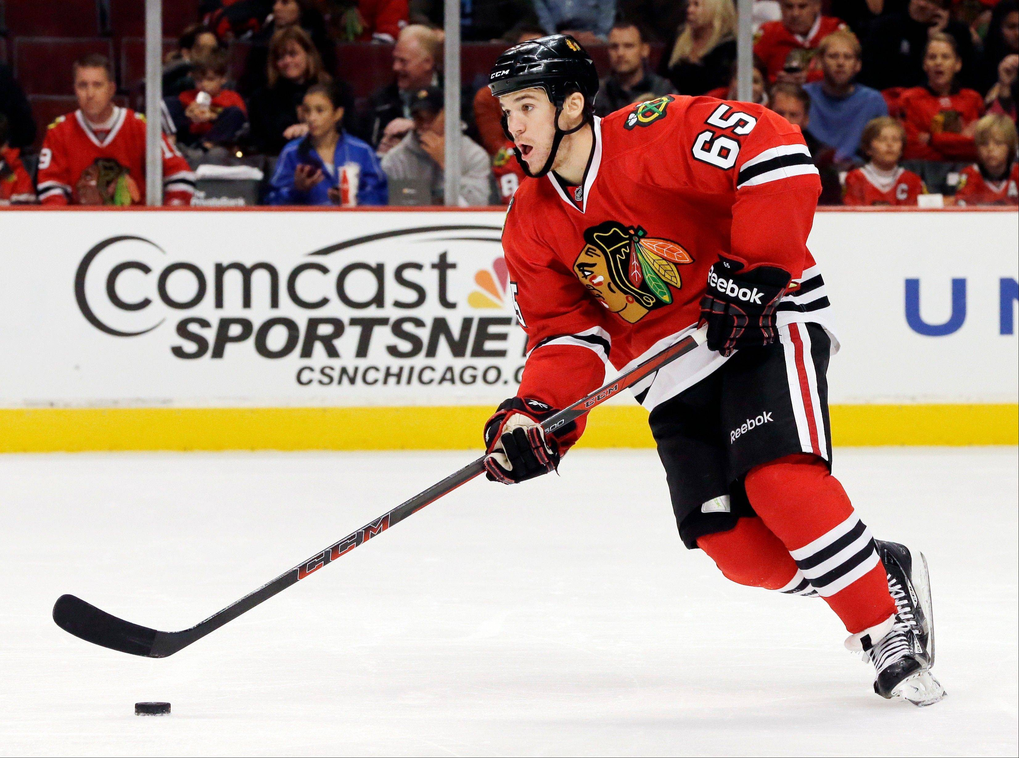 Andrew Shaw looks to pass during a game against Minnesota in October. Shaw had a big night Sunday against Edmonton in a 5-3 Hawks victory.