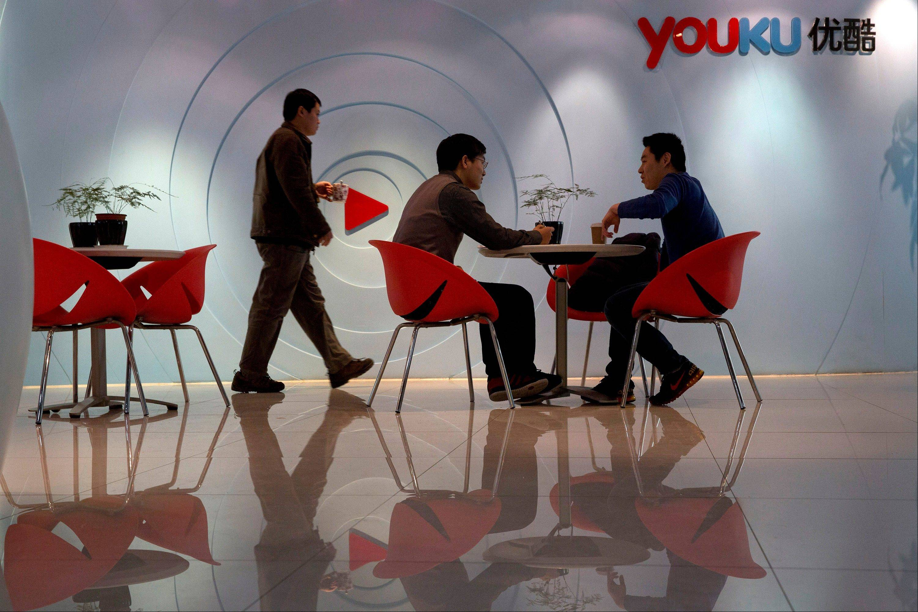 People meet at a lounge of the Youku headquarters in Beijing, China. In China, pirate DVDs in stores and on the street were traditionally the fastest way to get access to a film, and cheaper than going to the theater. A few years ago, piracy also dominated online. Today, China�s major video streaming sites have deals with Hollywood studios and others and are filled with licensed content.
