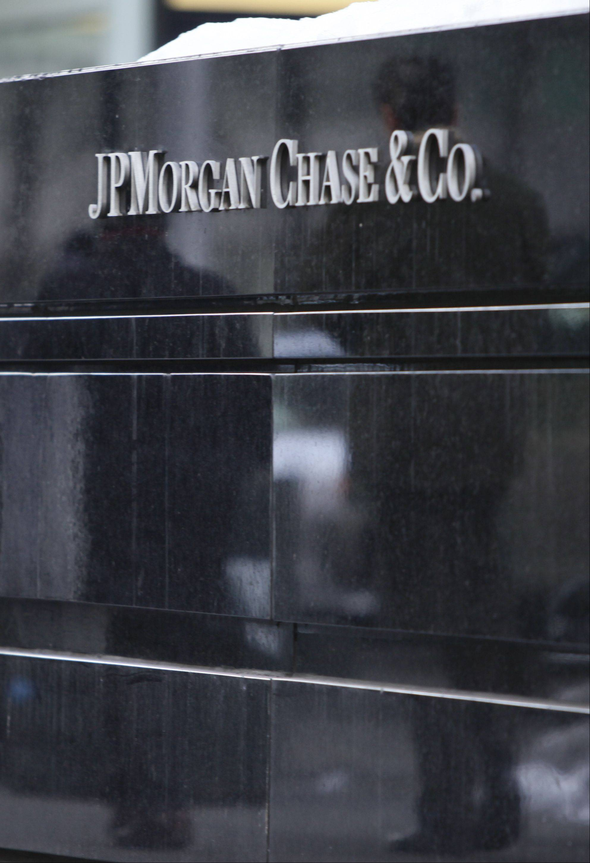 JPMorgan Chase, the biggest U.S. bank by assets, says it returned to a profit in the fourth quarter. The bank said it had net income of $5.3 billion in the last three months of 2013, compared with a profit of $5.7 billion in the same period a year earlier.