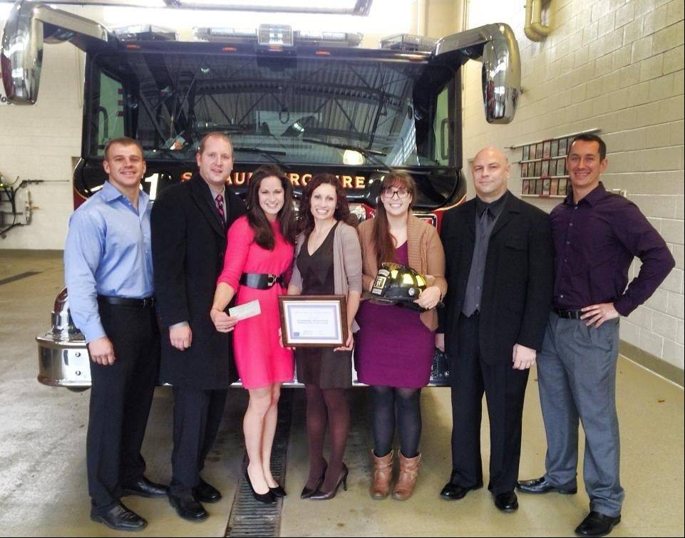 Members of the Schaumburg Professional Firefighters Association�s Fighting Cancer Committee, from left: firefighter Eric Vitols; firefighter Michael Solberg; firefighter Jenna Werdell; American Cancer Society representatives; firefighter Don McCown and firefighter Kyle Marcussen.