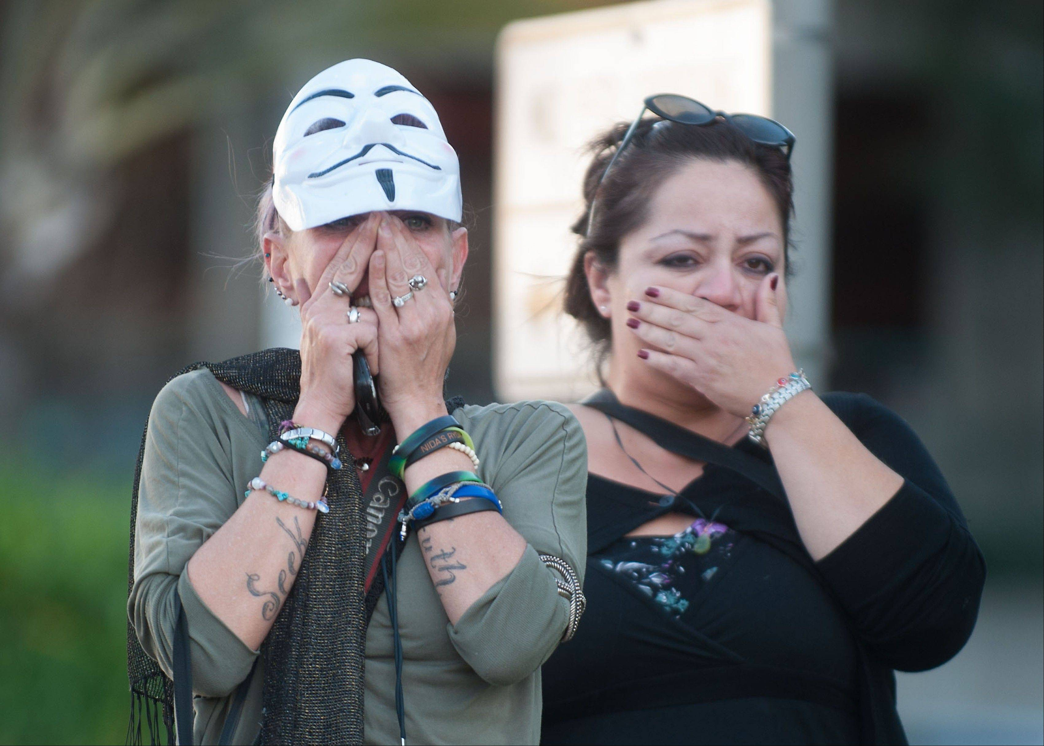 Shocked supporters of Kelly Thomas react Monday Jan. 13, 2014, in Santa Ana, Calif., after the �not guilty� verdicts in his beating death outside the Santa Ana Courthouse. The Orange County panel found Manuel Ramos and Jay Cicinelli not guilty of all charges � including manslaughter � in the 2011 death of Kelly Thomas. A surveillance video showed police pummeling and stun-gunning him.