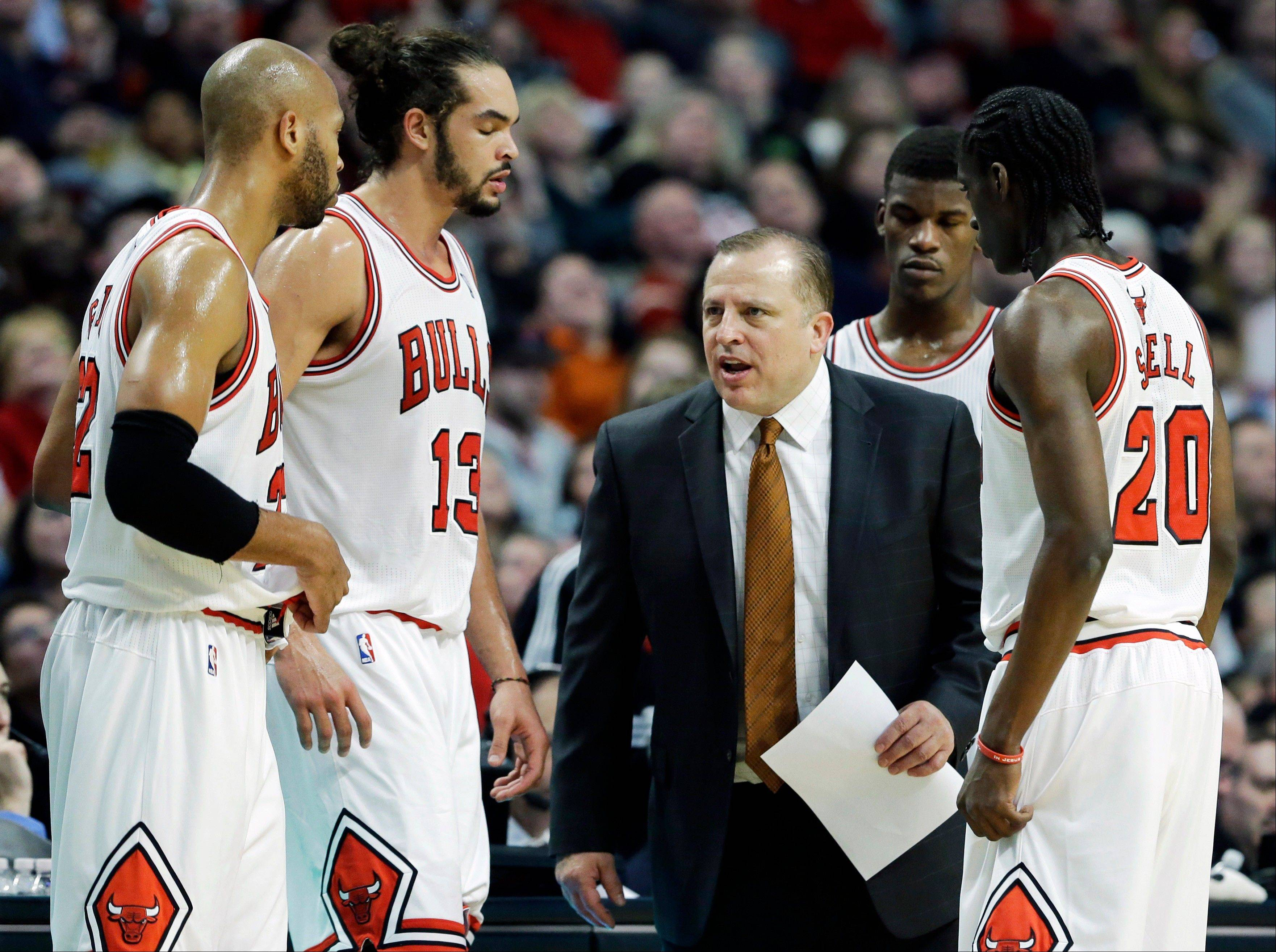 Chicago Bulls head coach Tom Thibodeau talks to his team during the second half of an NBA basketball game against the Dallas Mavericks in Chicago on Saturday, Dec. 28, 2013. The Mavericks won 105-83. (AP Photo/Nam Y. Huh)