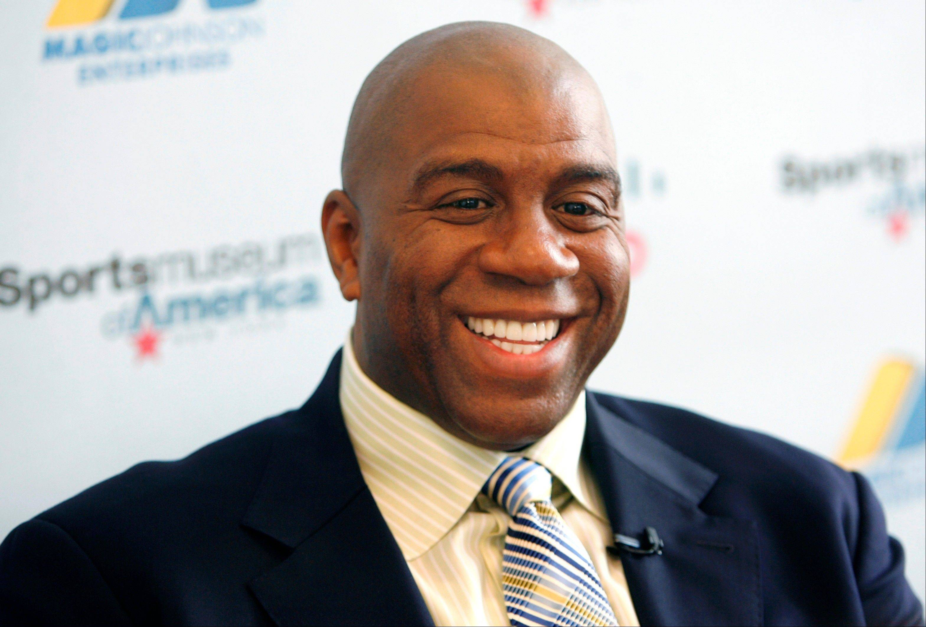 "Basketball legend turned entrepreneur Earvin ""Magic"" Johnson tours the Sports Museum of America in New York in this 2012 file photo."