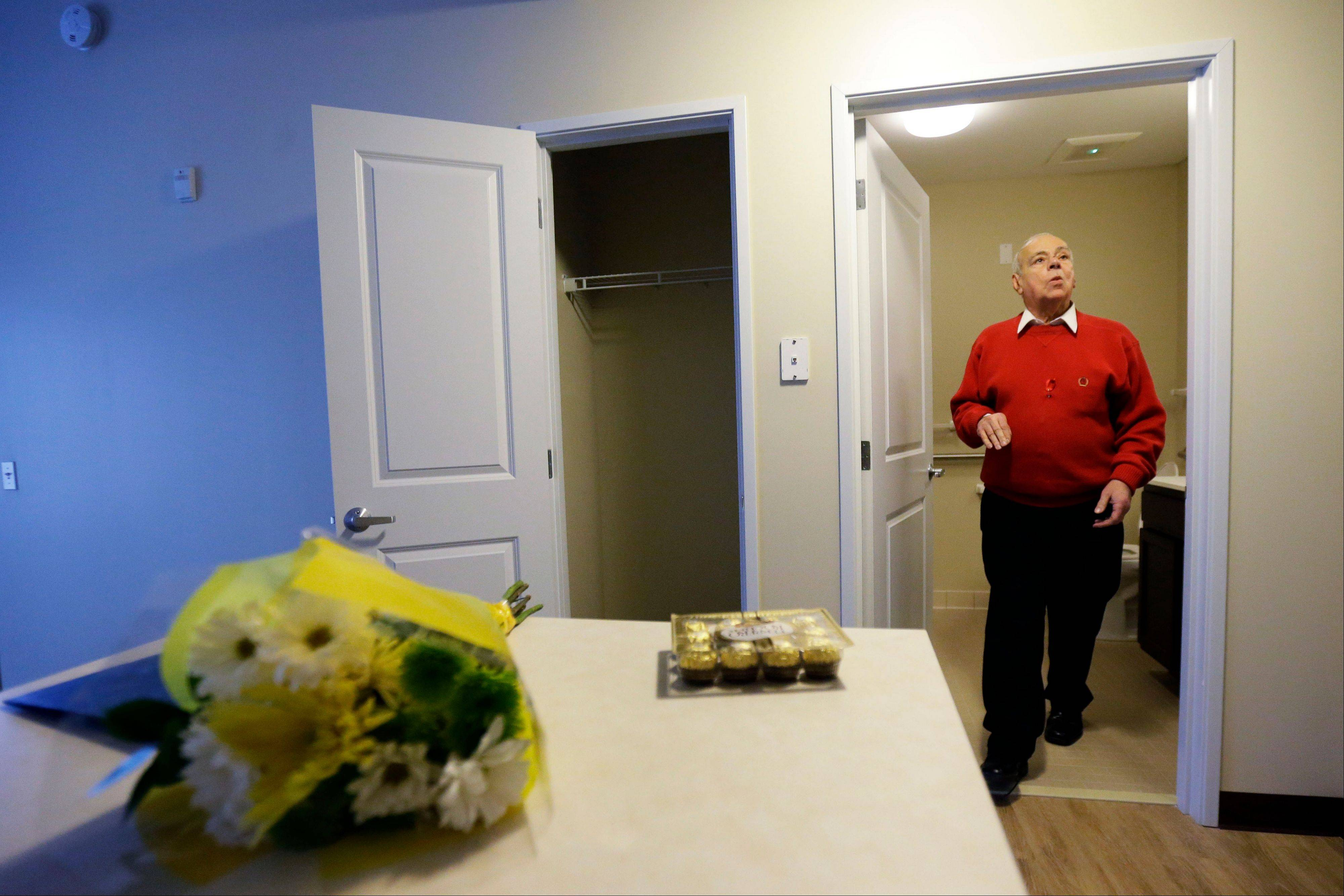 Jerry Zeft, 70, explores his new home in the John C. Anderson apartments, an affordable housing complex aimed at gay seniors.