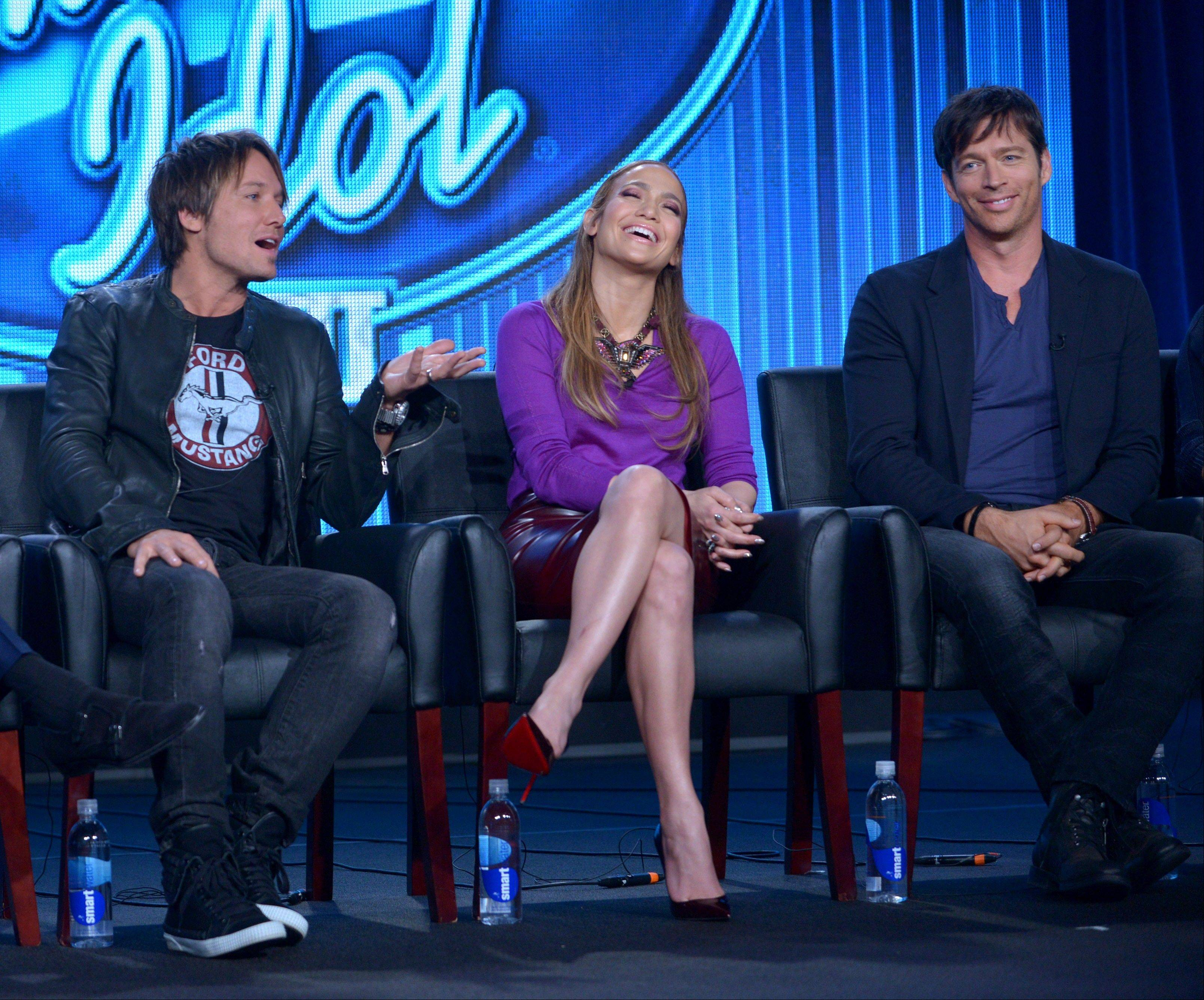 "Judges Keith Urban, left, Jennifer Lopez and Harry Connick Jr. discuss the newest season of ""American Idol"" at the FOX Winter 2014 TCA on Monday, Jan. 13."