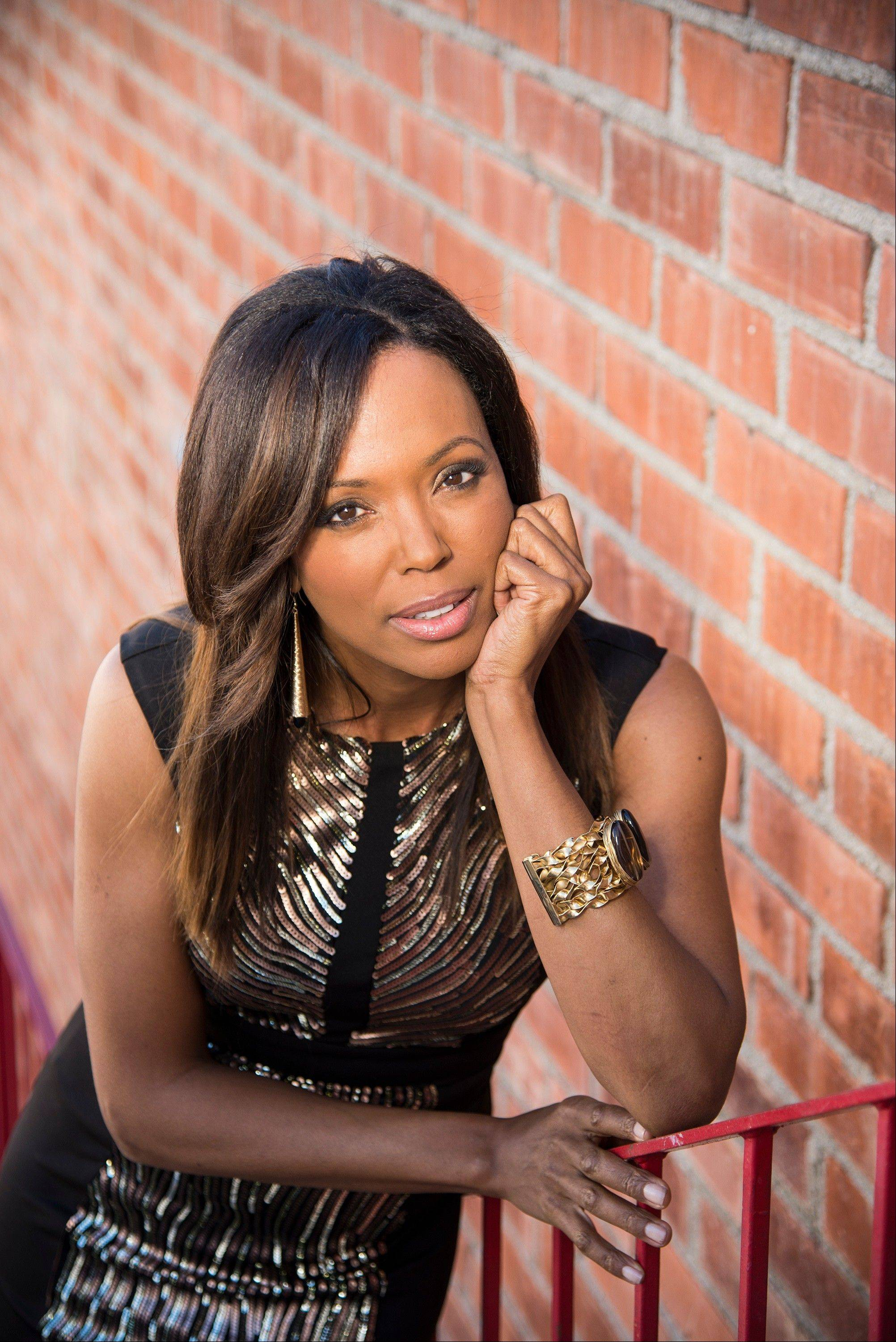 "Aisha Tyler is a regular panelist on the CBS' show ""The Talk."" She is also the voice of agent Lana Kane on FX animated series, ""Archer,"" the fifth season of which premiered Monday."