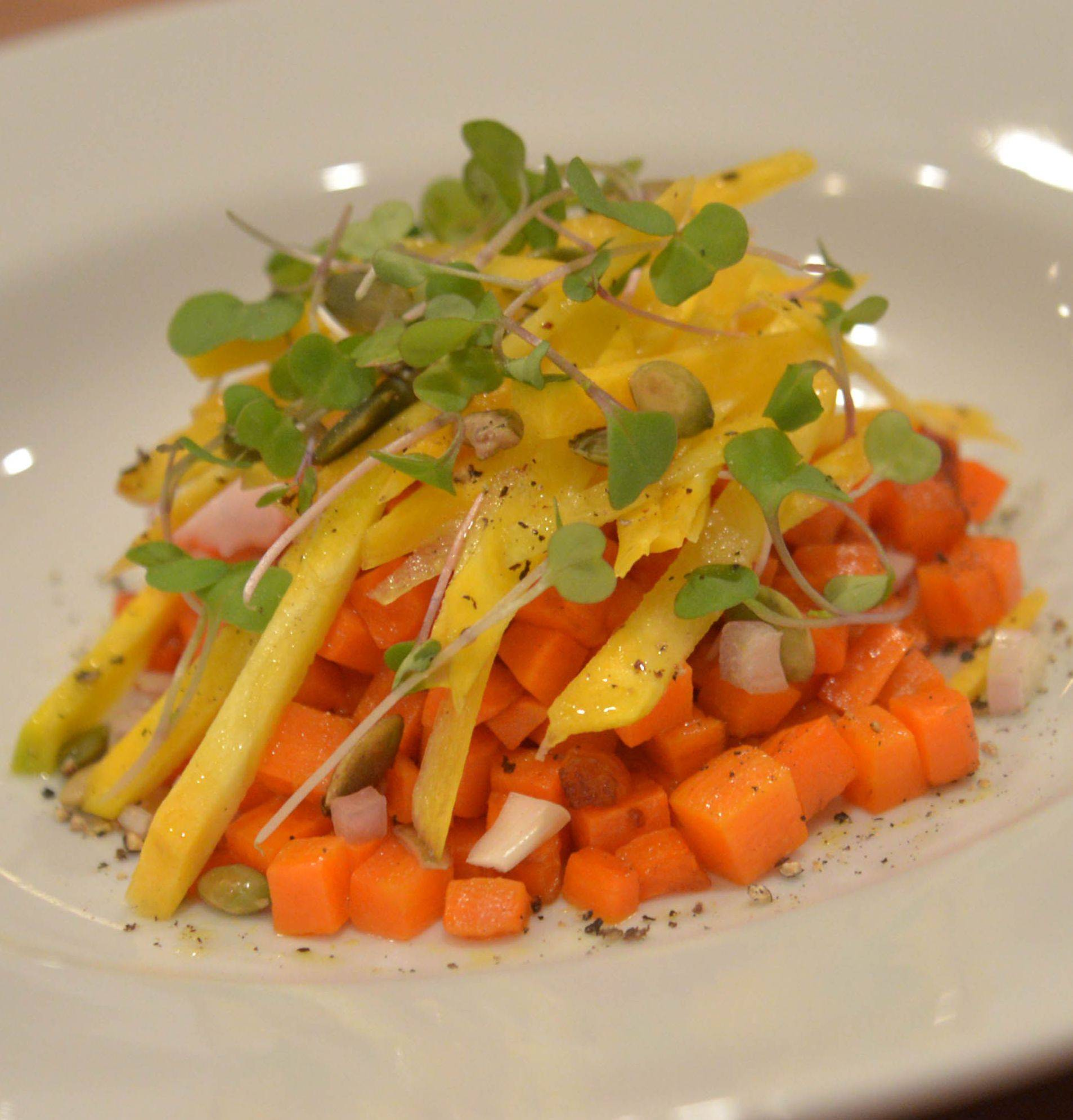 Elliott Papineau serves carrots, hot and cold, in the same dish.
