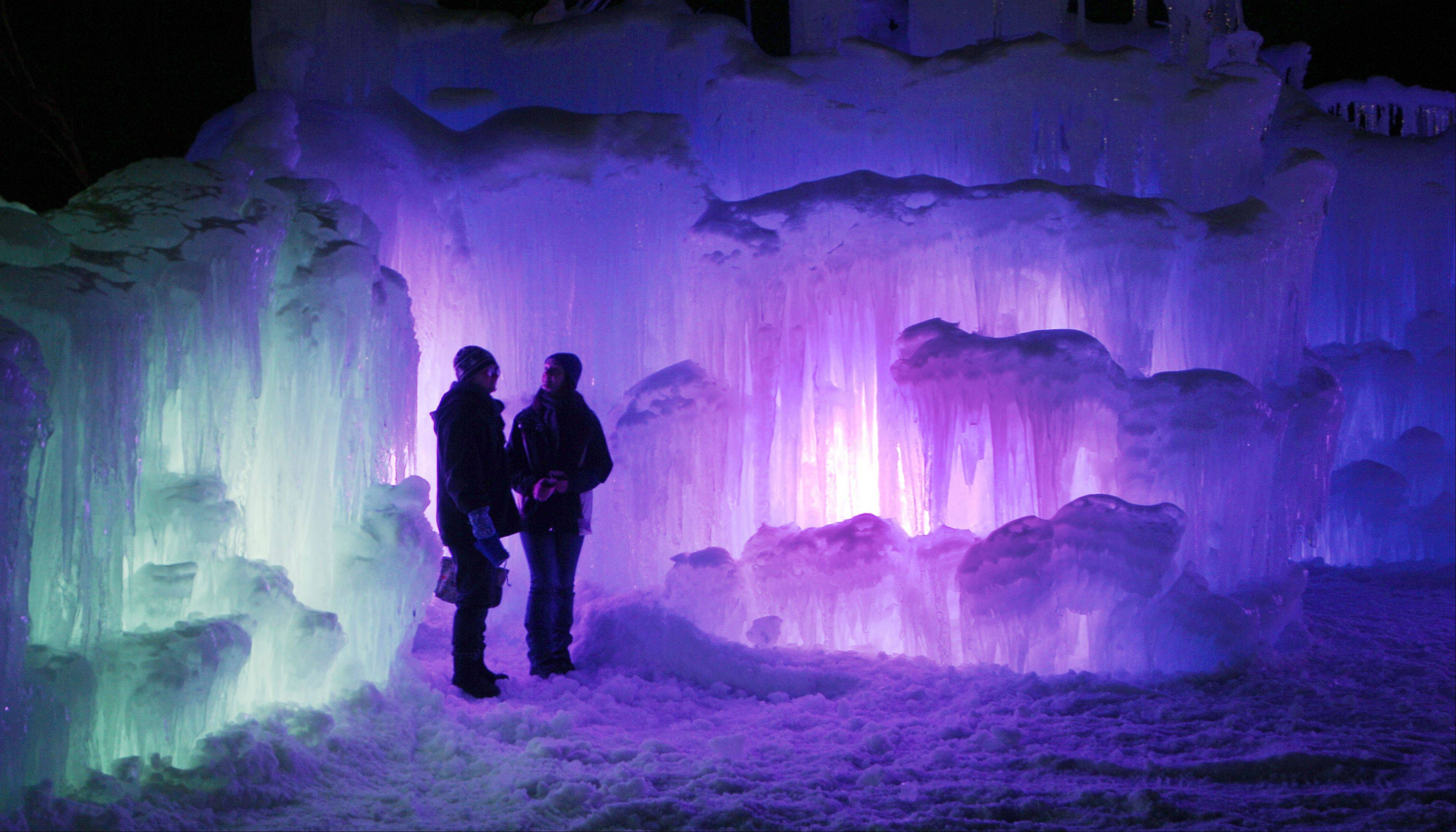 At night, the ice castles at the base of the Loon Mountain ski resort in Lincoln, N.H., are lit by color-changing LED lights embedded in the ice.