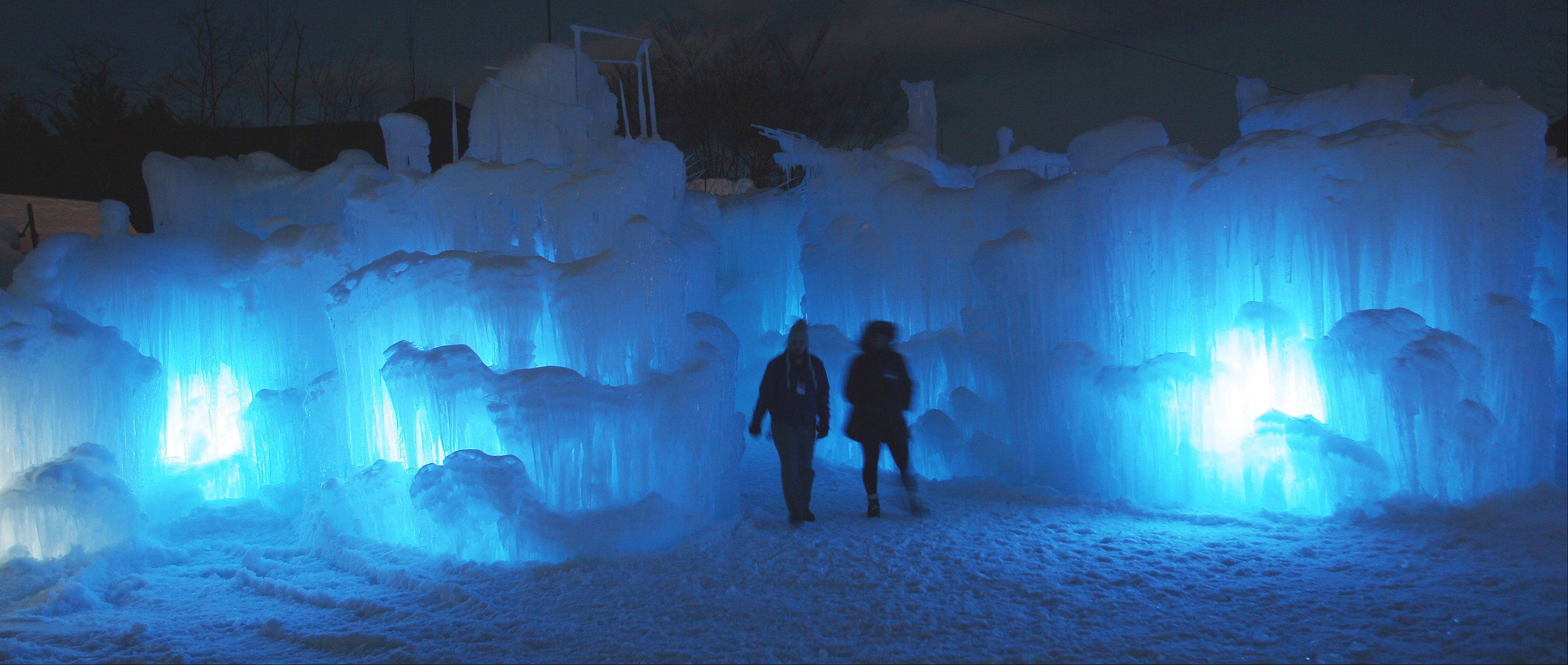 Visitors tour an ice castle at the base of the Loon Mountain ski resort in Lincoln, N.H. There are 58 towers on the Lincoln castle, plus a waterfall and an enclosed slide.