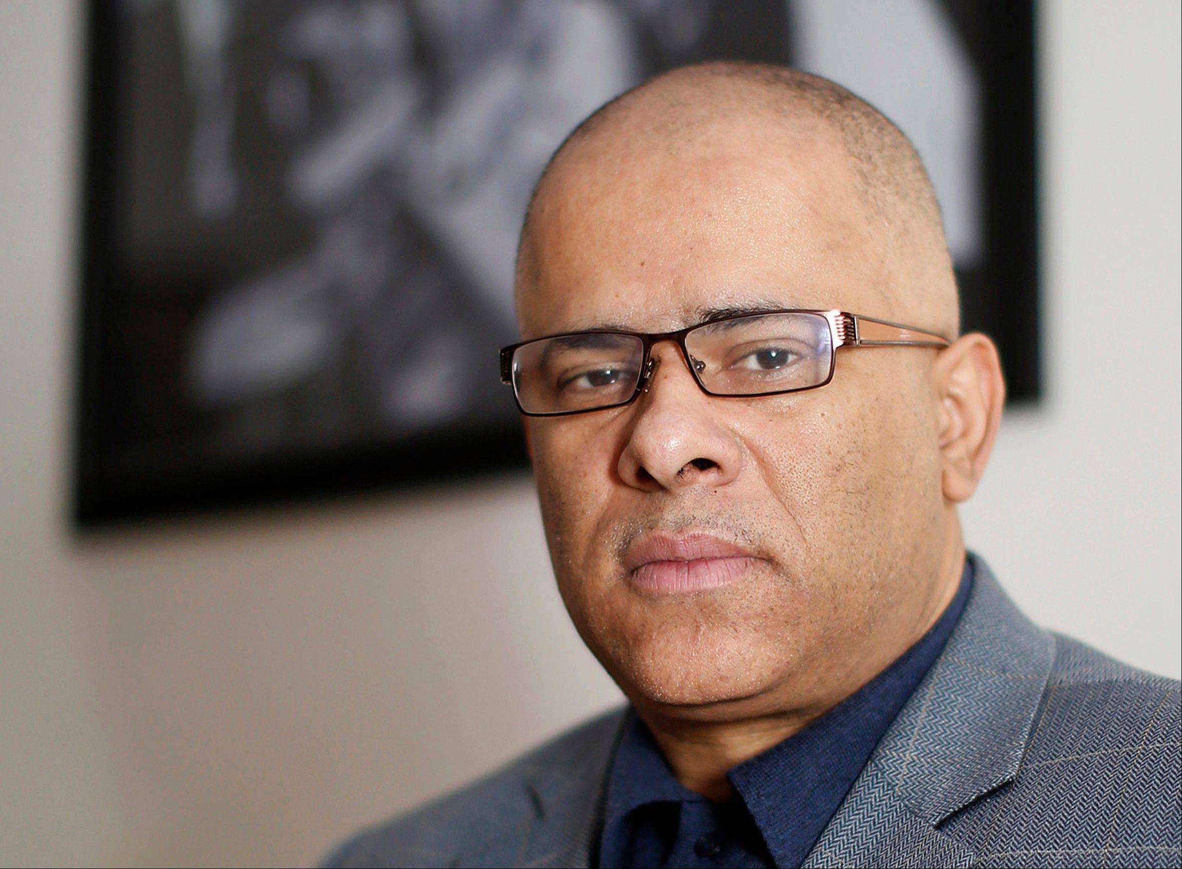 "This April 12 file photo shows Tio Hardiman, then the director of the Chicago anti-violence group CeaseFire, in his office in Chicago. Illinois elections officials are expected to decide next week whether Hardiman can remain on the ballot to challenge Gov. Pat Quinn in the 2014 Democratic primary. The issue is whether lieutenant governor candidate Brunell Donald used her correct address on petitions. The Chicago woman says she'd recently moved, but didn't change the address on her voter registration. Hardiman said Thursday he's ""ready to tackle all of the issues."""