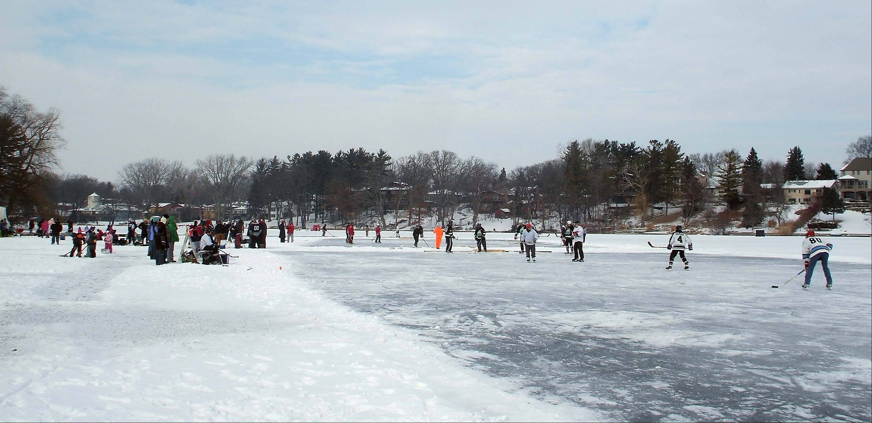 At the first Lake In The Hills pond hockey tourney, public works employees drilled a hole in Woods Creek Lake and pumped water on top of the ice to create two smooth ice rinks.
