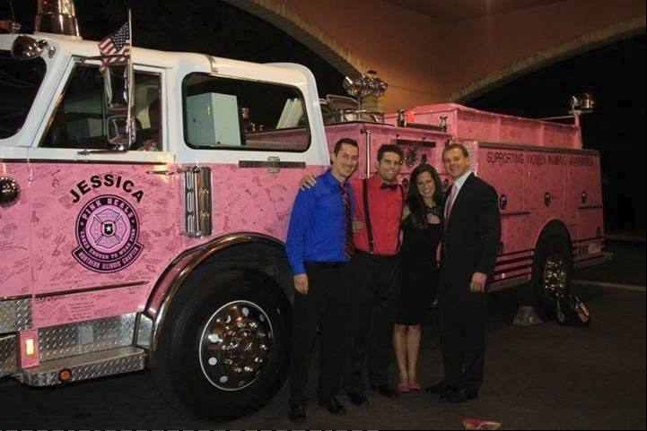 The Pink Heals Fire Engine and four members of the Fighting Cancer Committee, from left, Kyle Marcussen, Edward Steineke, Jenna Werdell and Eric Vitols.