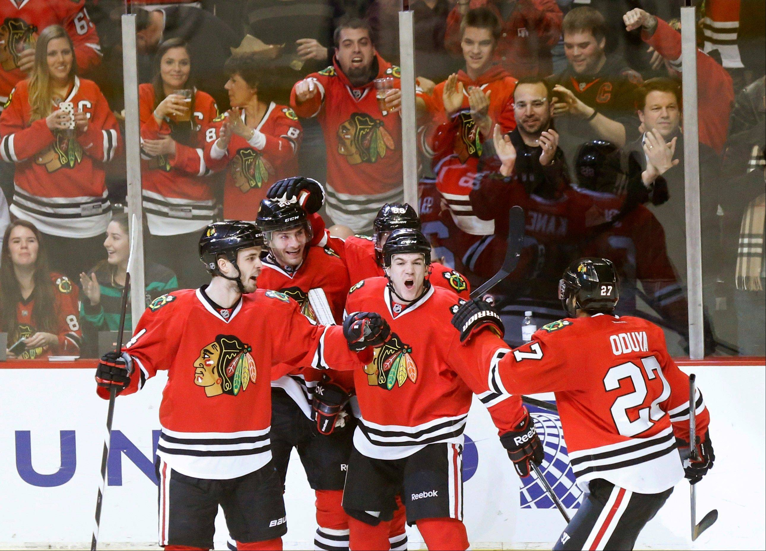The Blackhawks' Johnny Oduya celebrates his goal with teammates from left, Niklas Hjalmarsson (4) Brandon Saad, Andrew Shaw and Patrick Kane (behind Shaw), during the second period Tuesday against the Avalanche at the United Center.