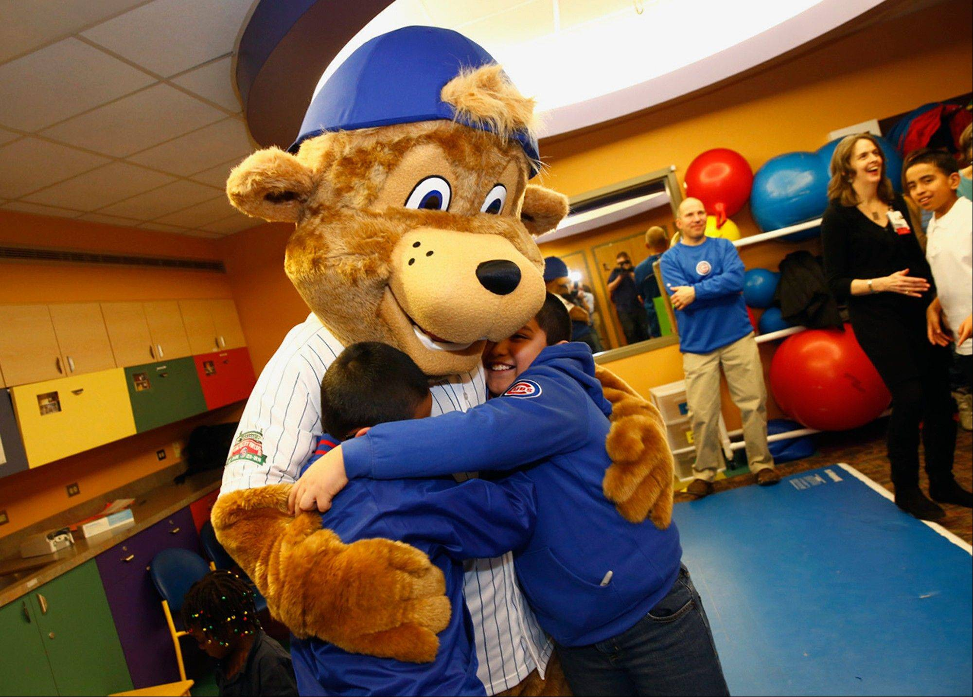 Clark, the first mascot for the Chicago Cubs, hugs children during his debut at Advocate Illinois Masonic�s Pediatric Developmental Center in Chicago.