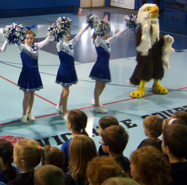 St Emily cheerleaders showing school spirit during an assembly.