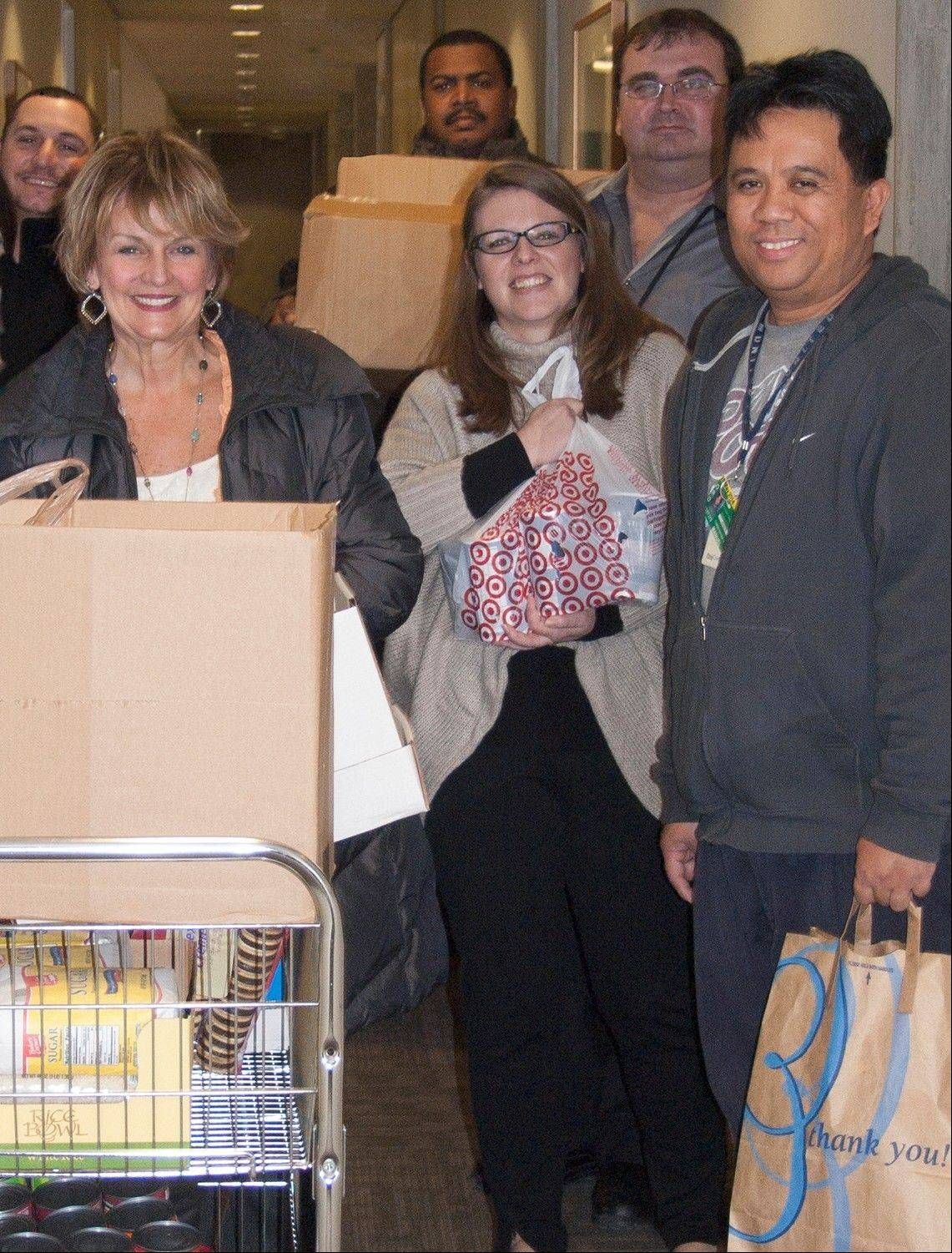 Employees at Alliant Credit Union are pictured with some of the hundreds of food and household items collected for Maine Township Community Food Pantry. Left to right are: Mark Wooster; Colleen Panzino, food drive coordinator; Martin Reavis; Samantha Warber; Stefan Ivanov; and Christopher Manuel. The items were donated by Alliant employees during the Chicago-based credit union's Holiday Food Drive. The food pantry serves the needs of people living in several Northwest suburban Chicago communities.