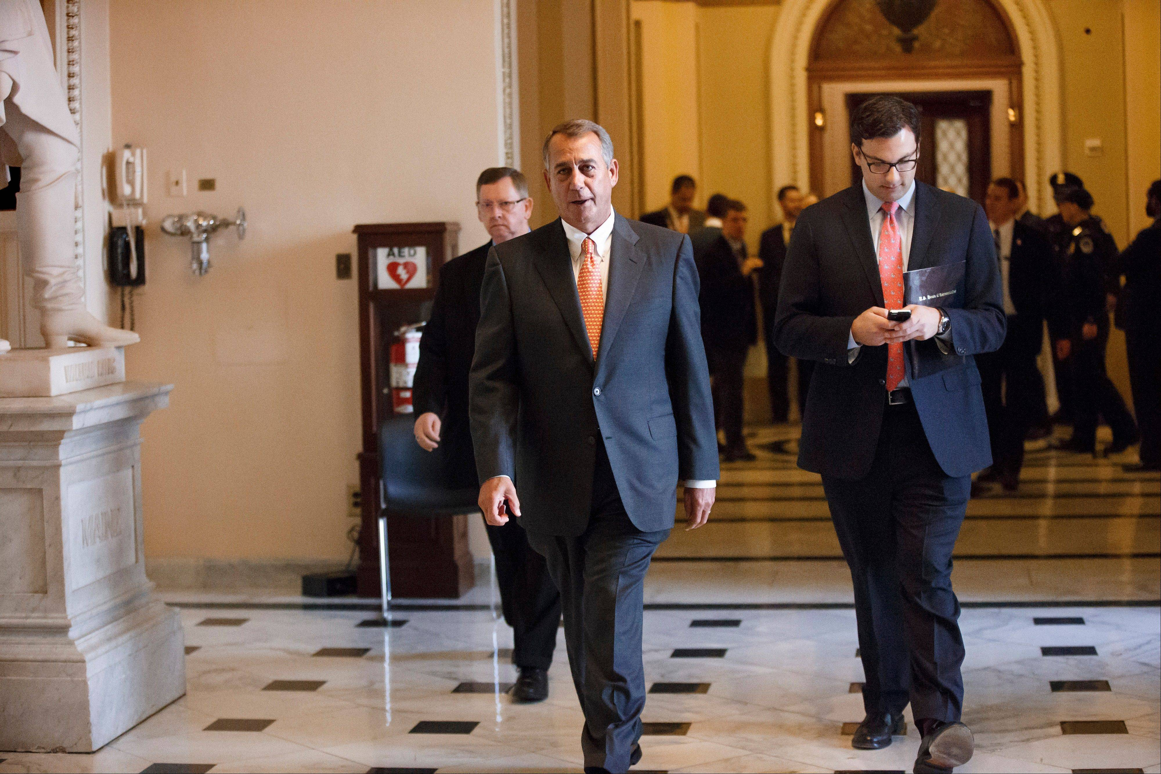 House Speaker John Boehner leaves the House chamber on Capitol Hill Wednesday after the final vote on a massive $1.1 trillion spending bill. The measure sailed through the House with no suspense and little dissent � fueled additionally by lawmakers� desire to avoid an election-year replay of last fall�s widely unpopular 16-day federal shutdown.