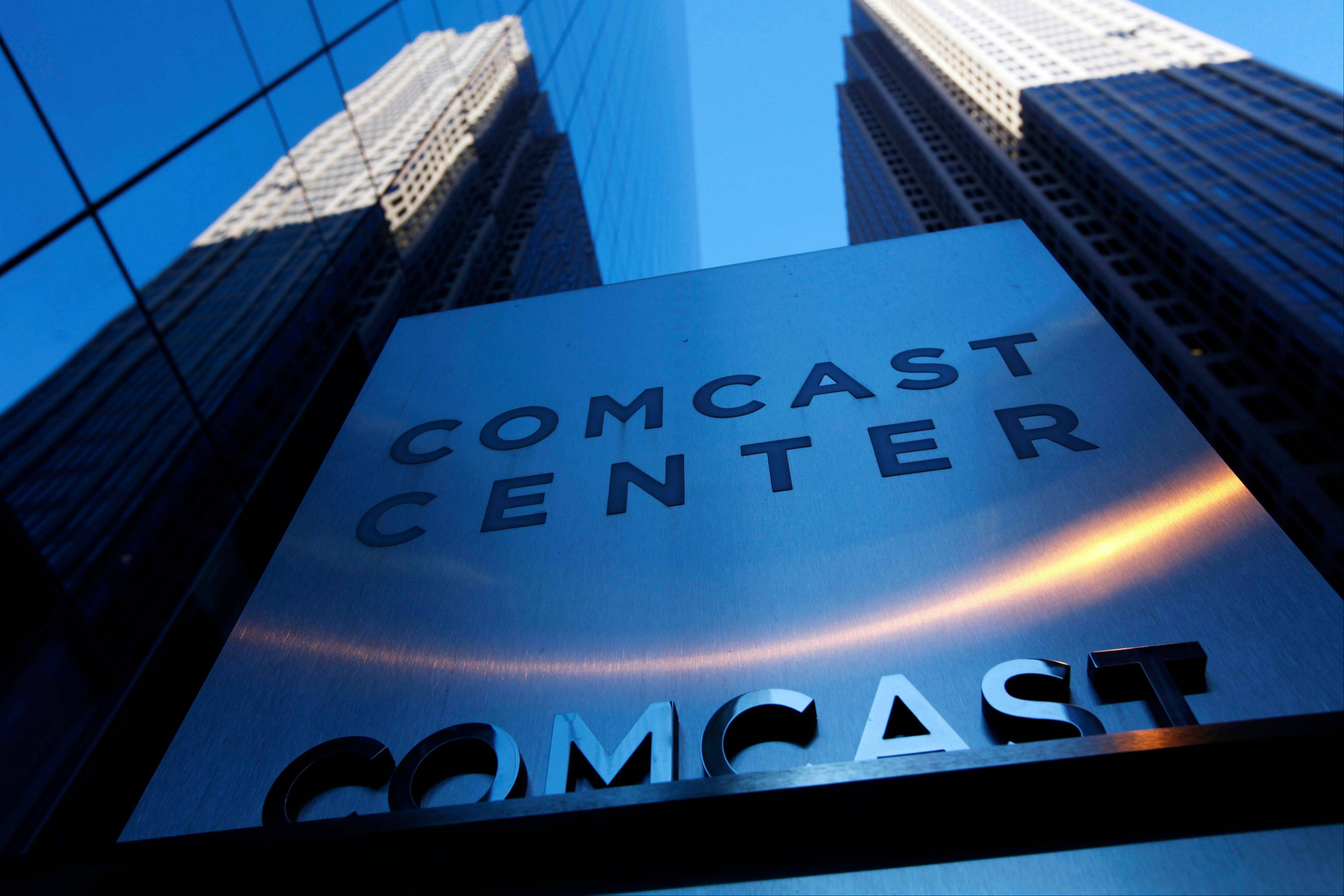 A sign outside the Comcast Center, left, in Philadelphia. On Tuesday a three-judge panel of the U.S. Court of Appeals for the D.C. Circuit affirmed that the FCC had authority to create open-access rules. But in a setback for the Obama administration's goal of Internet openness, the court ruled that the FCC failed to establish that its 2010 regulations don't overreach.