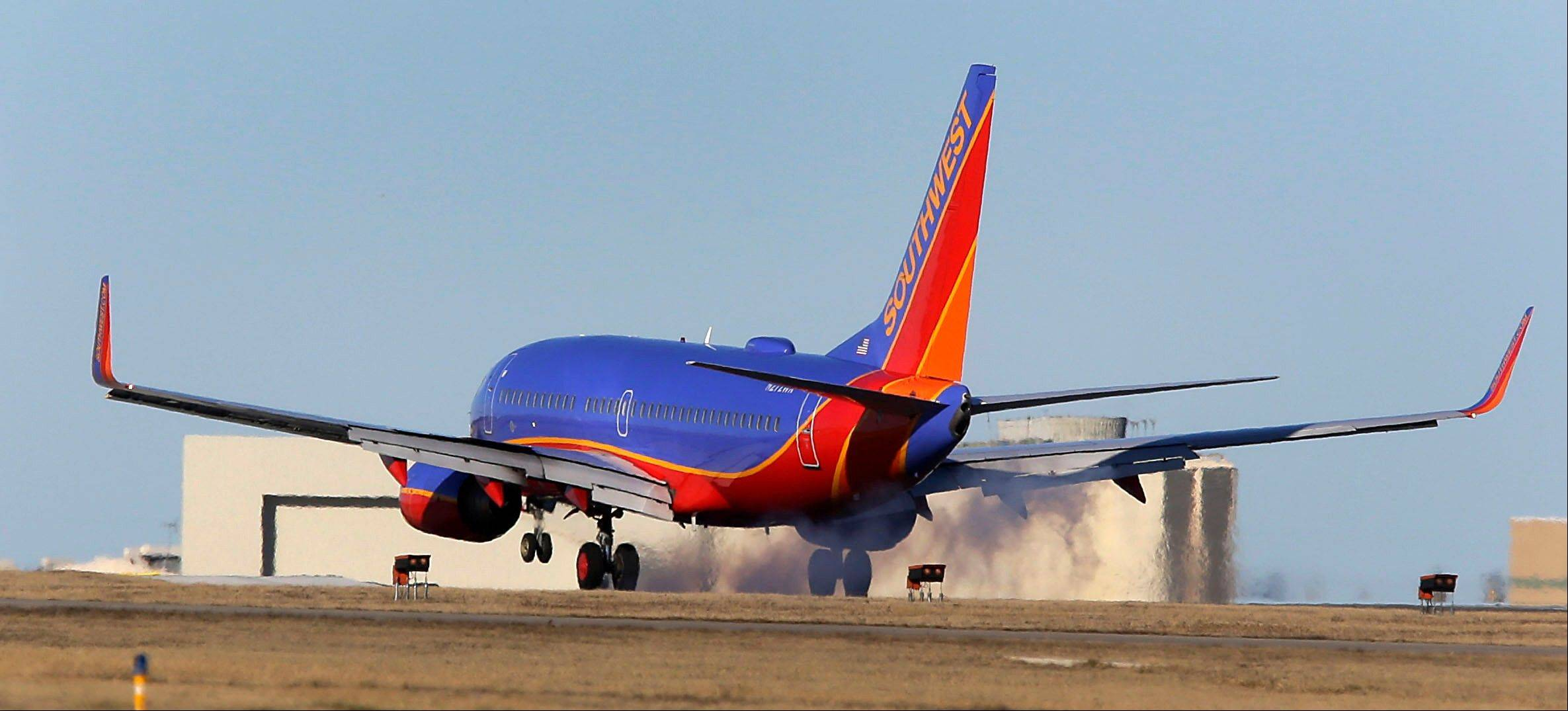 A third person in the cockpit of a Southwest Airlines plane that landed at the wrong Missouri airport was a company dispatcher who had authority to be there, airline officials said Tuesday.
