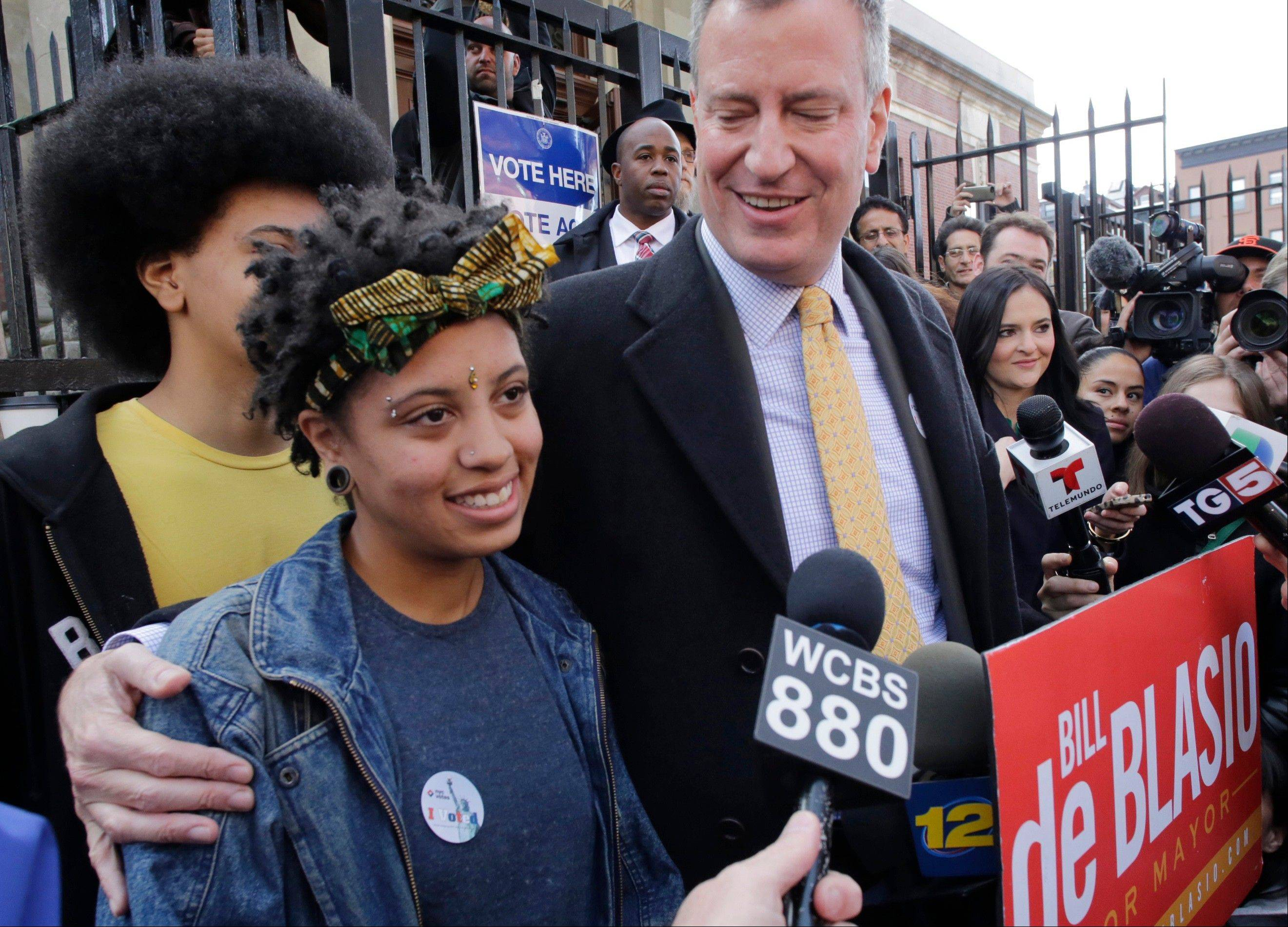 Chiara de Blasio stands with her father, then Democratic mayoral candidate Bill de Blasio, and her brother, Dante, left, after her father voted in Brooklyn, New York. On Christmas Eve, Chiara, 19, bared her soul on YouTube about her history of depression and substance abuse, and urged others to get help.