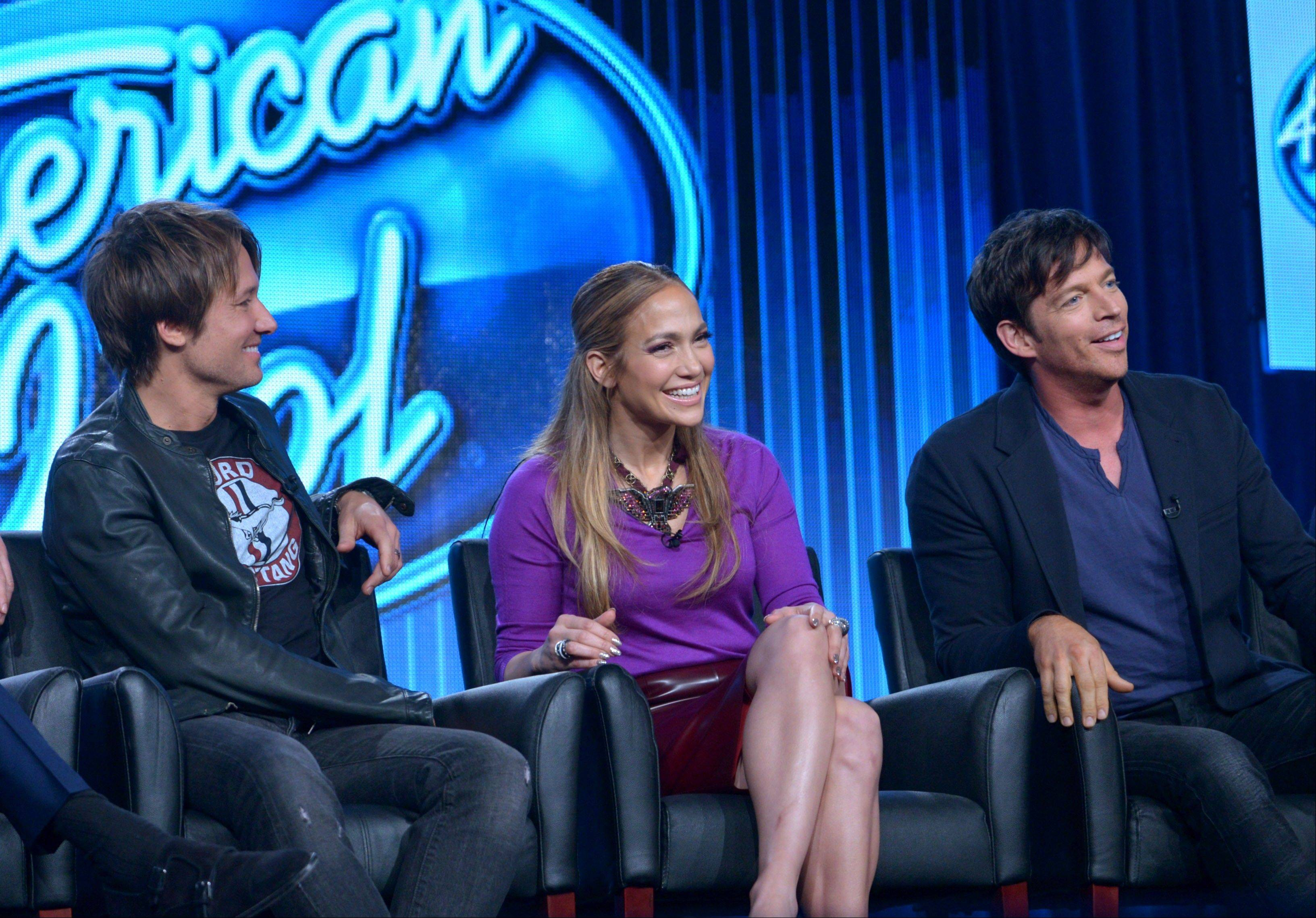 Keith Urban, left, Jennifer Lopez and Harry Connick Jr. preview �American Idol� at the FOX Winter 2014 TCA on Monday. The producers of the show say the new season includes changes to freshen it, including an expanded song list for contestants.