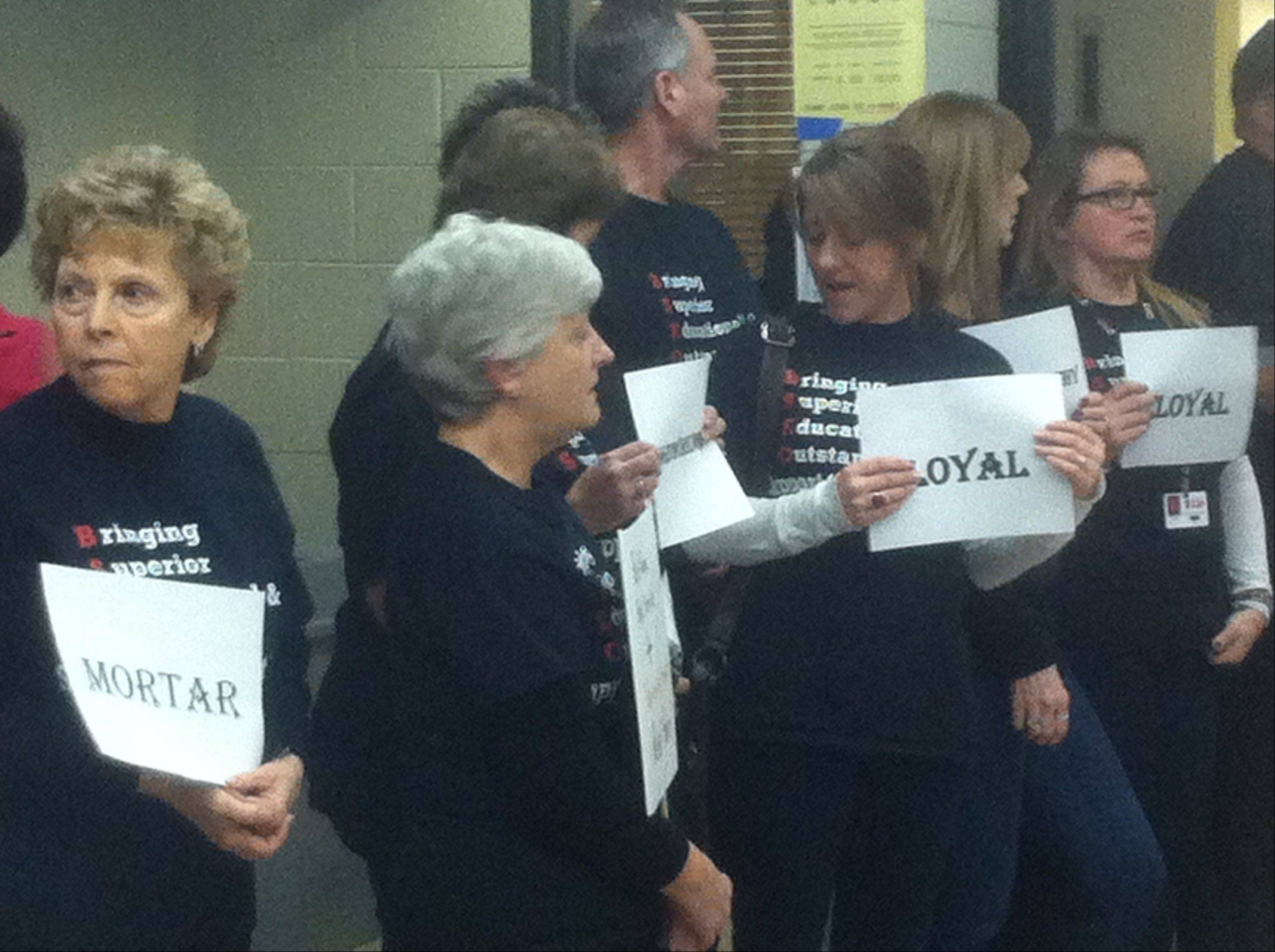 Members of the Barrington School Employees Organization protested their lack of a contract outside the Barrington Unit District 220 Board of Education meeting Tuesday night. The two sides have been negotiating for a new deal since May, and are now in federal mediation trying to reach an agreement.