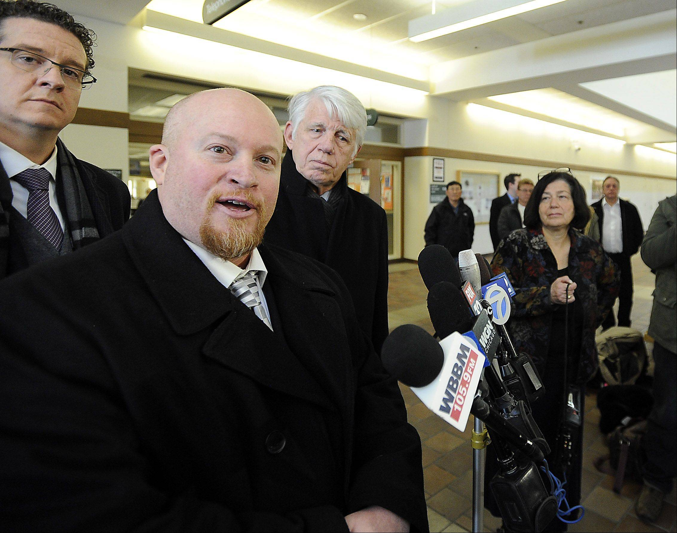 Former Maine West High School soccer coach Michael Divincenzo talks to reporters after he was acquitted of a hazing charge Wednesday.