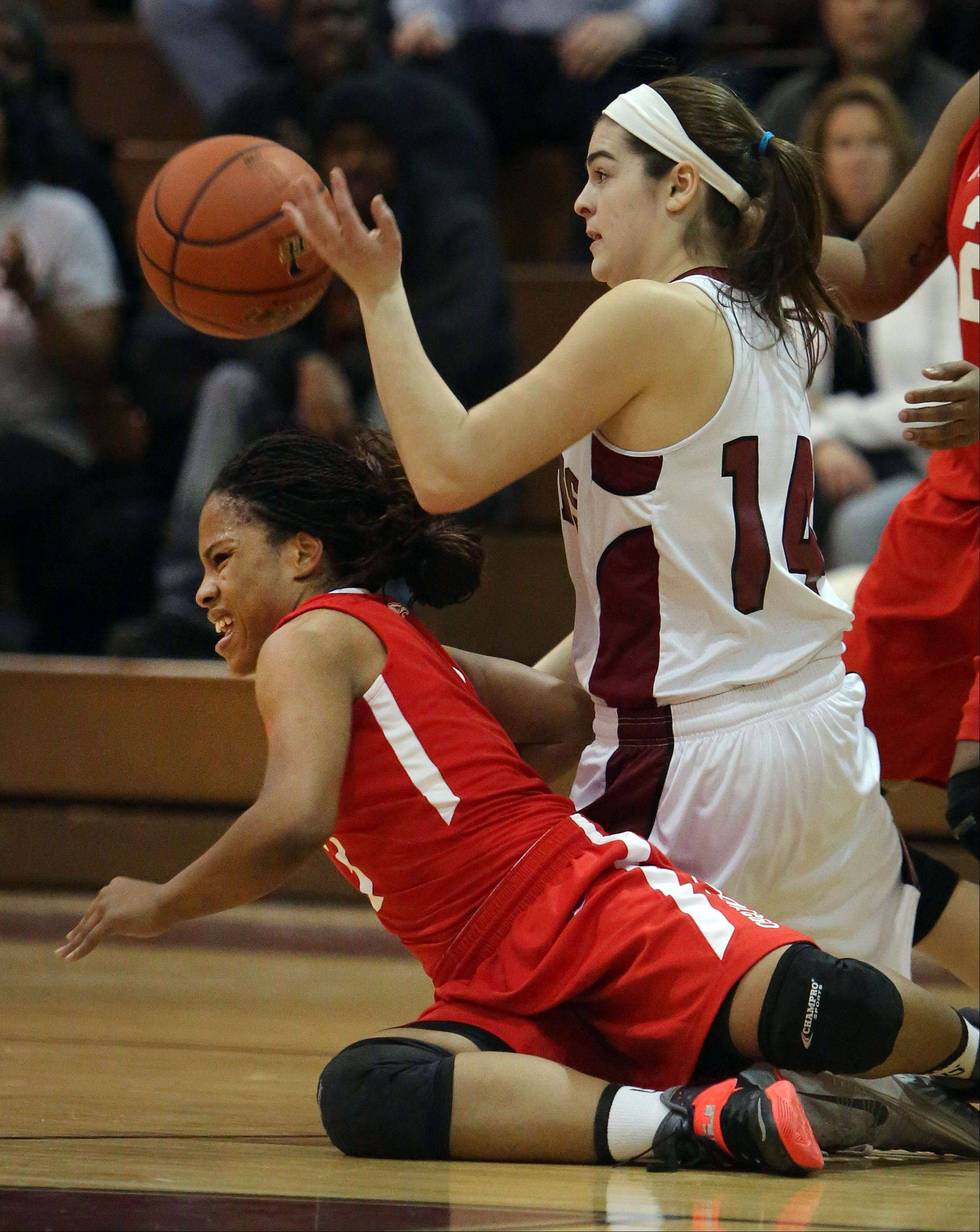 Antioch�s Amy Reiser, right, and North Chicago�s Alexis Means scramble for a loose ball on Wednesday night at Antioch.