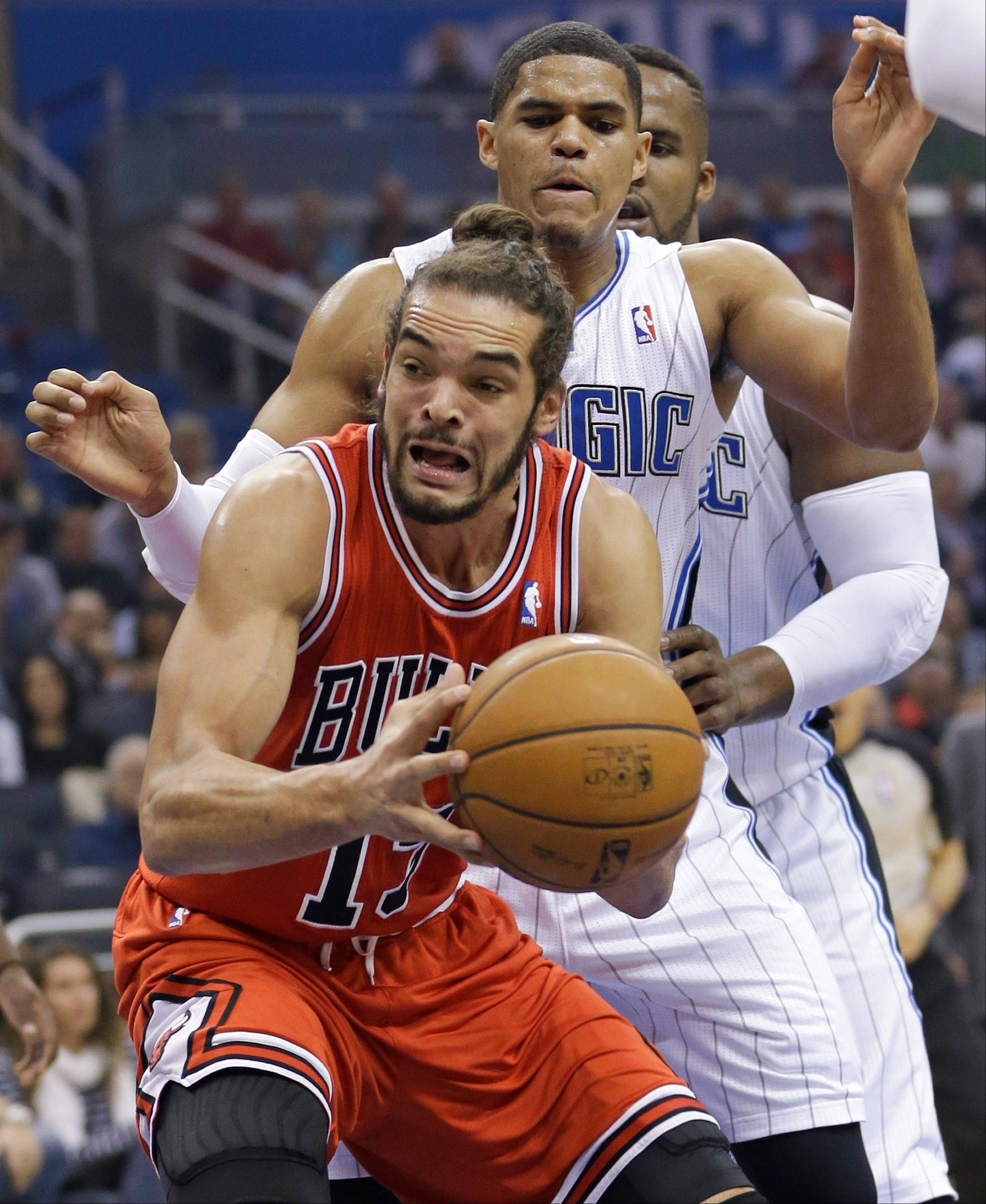 Chicago Bulls� Joakim Noah, front, looks to go up for a shot off a rebound in front of Orlando Magic�s Tobias Harris during the first half Wednesday in Orlando. The Bulls beat the Magic 128-125 in triple overtime.