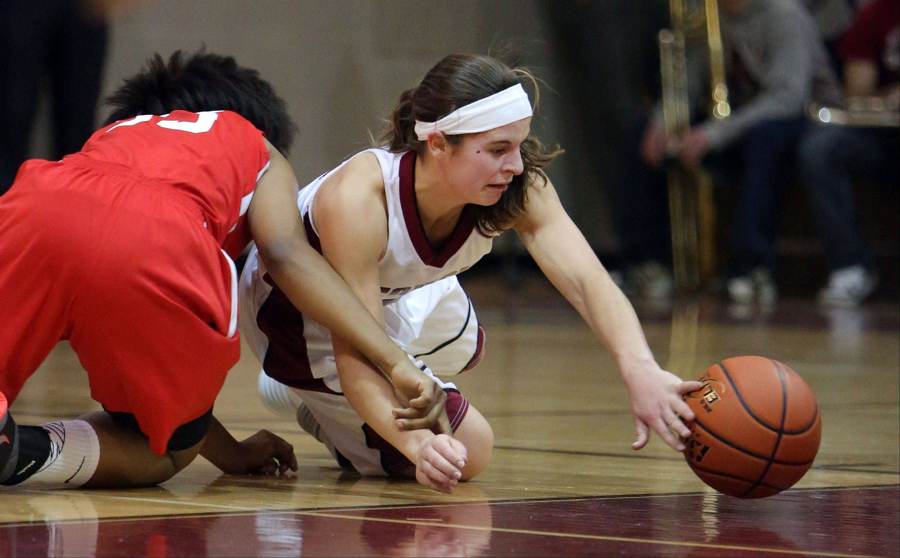 Antioch�s Ashley Reiser, right, and North Chicago�s Tiara Garrett go after loose ball.