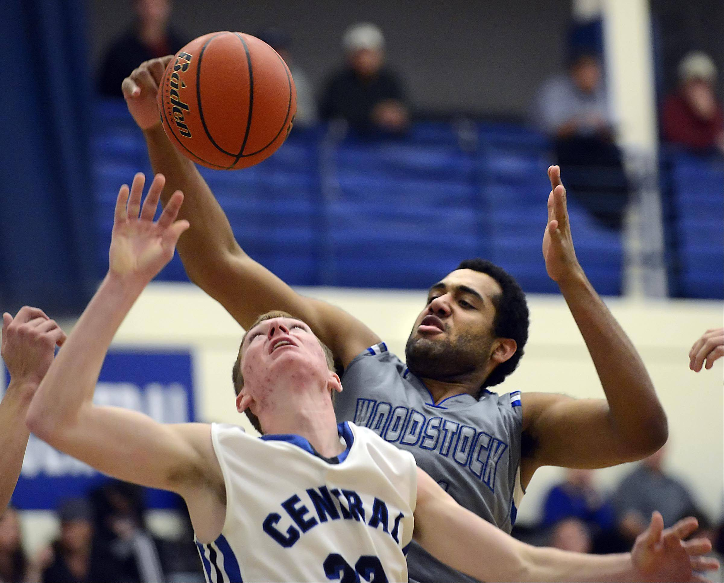 Burlington Central�s Sean Fitzgerald and Woodstock�s Damian Stoneking compete for a rebound.