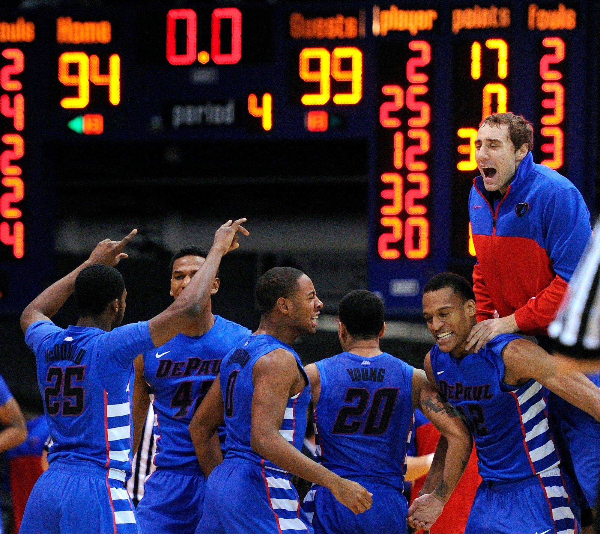DePaul players celebrate after defeating beating Butler in an NCAA college basketball game Thursday, Jan. 9, 2014, in Indianapolis. DePaul won 99-94 in double overtime.