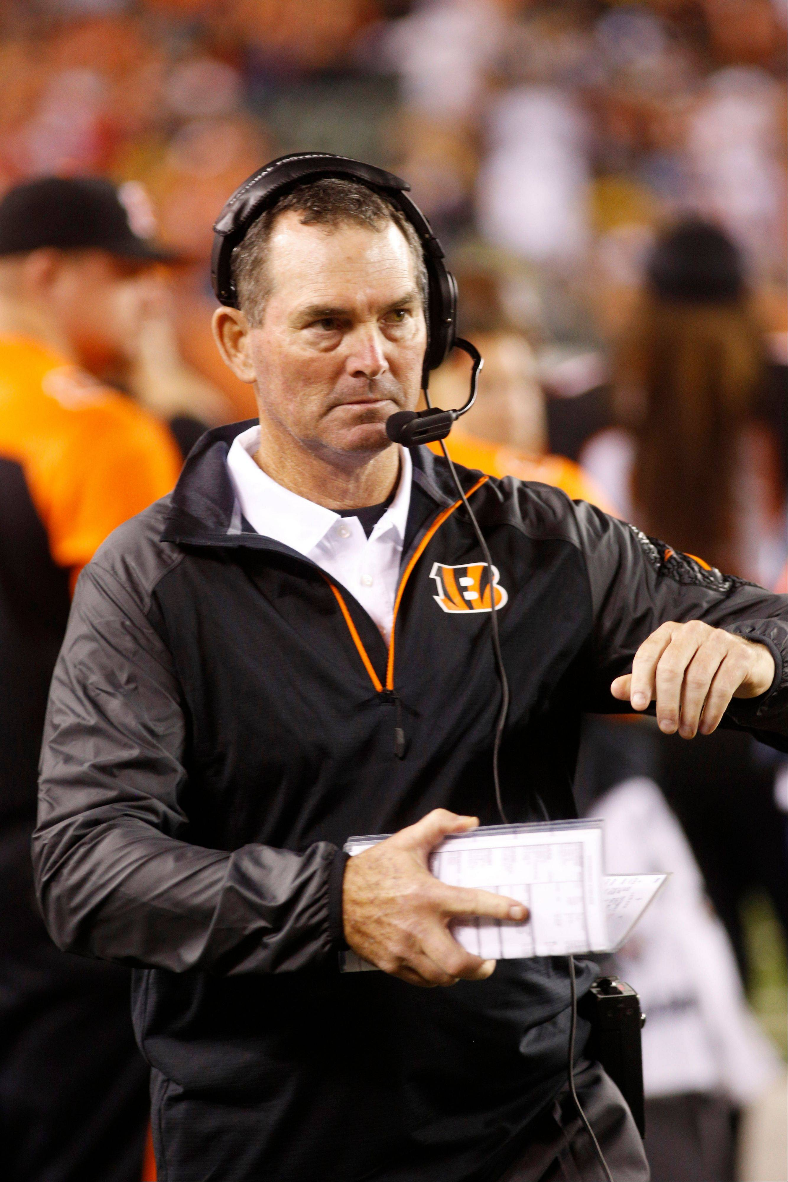 FILE - IN this Sept. 17, 2013 file photo, Cincinnati Bengals defensive coordinator Mike Zimmer watches from the sidelines in the second half of an NFL football game against the Pittsburgh Steelers, in Cincinnati. The Minnesota Vikings have chosen Zimmer as their new head coach, according to multiple media reports. Zimmer will replace Leslie Frazier, who was fired after the team finished 5-10-1 this season. (AP Photo/David Kohl, File)