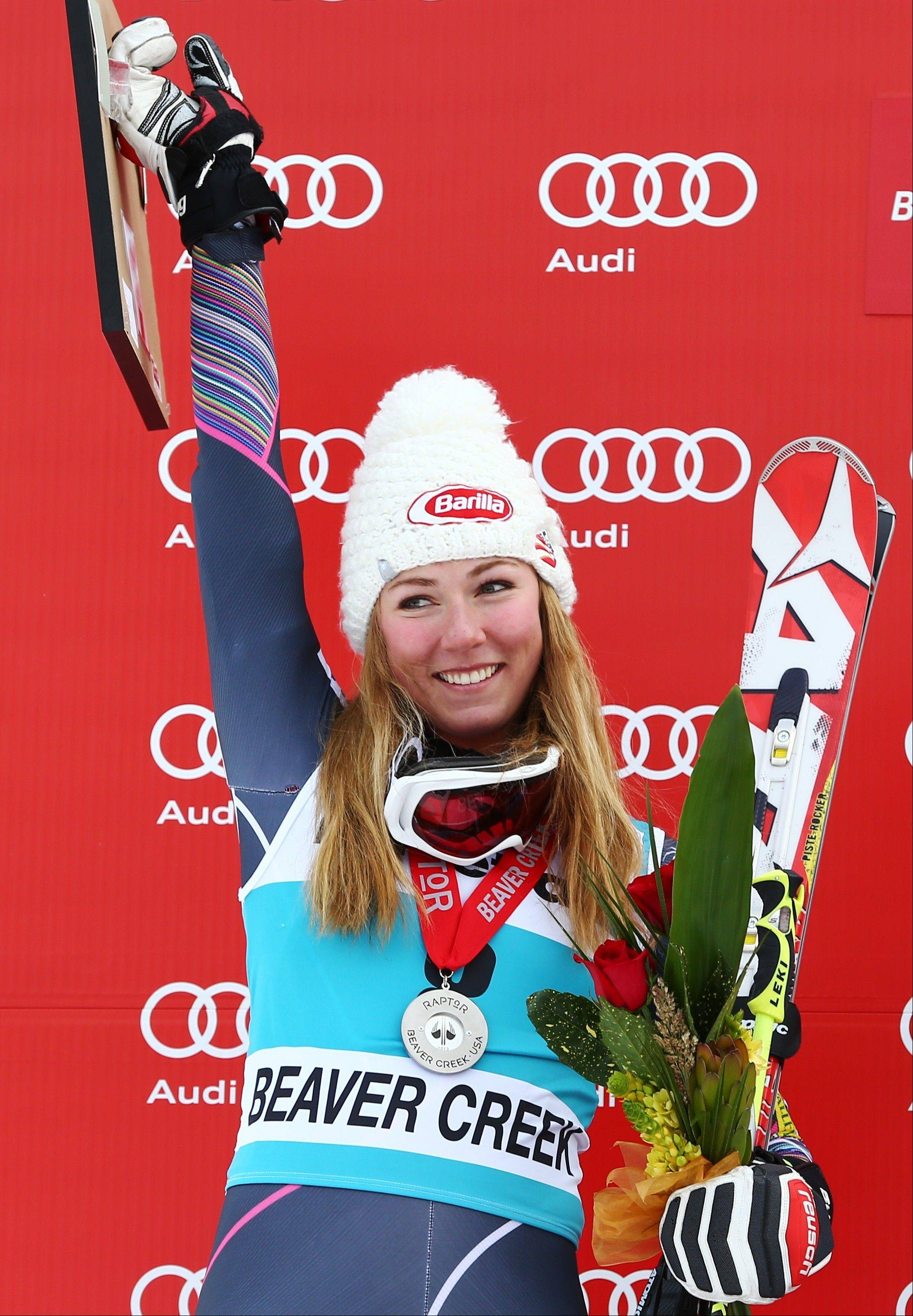 ADVANCE FOR WEEKEND OF JAN. 11-12 - FILE - In this Dec. 1, 2013, file photo, Mikaela Shiffrin smiles while standing on the podium after the women's World Cup giant slalom skiing event in Beaver Creek, Colo. The 18-year-old Shiffrin could very well be the face of the Sochi Olympics, especially now that Lindsey Vonn is out with a knee injury. (AP Photo/Alessandro Trovati, File)