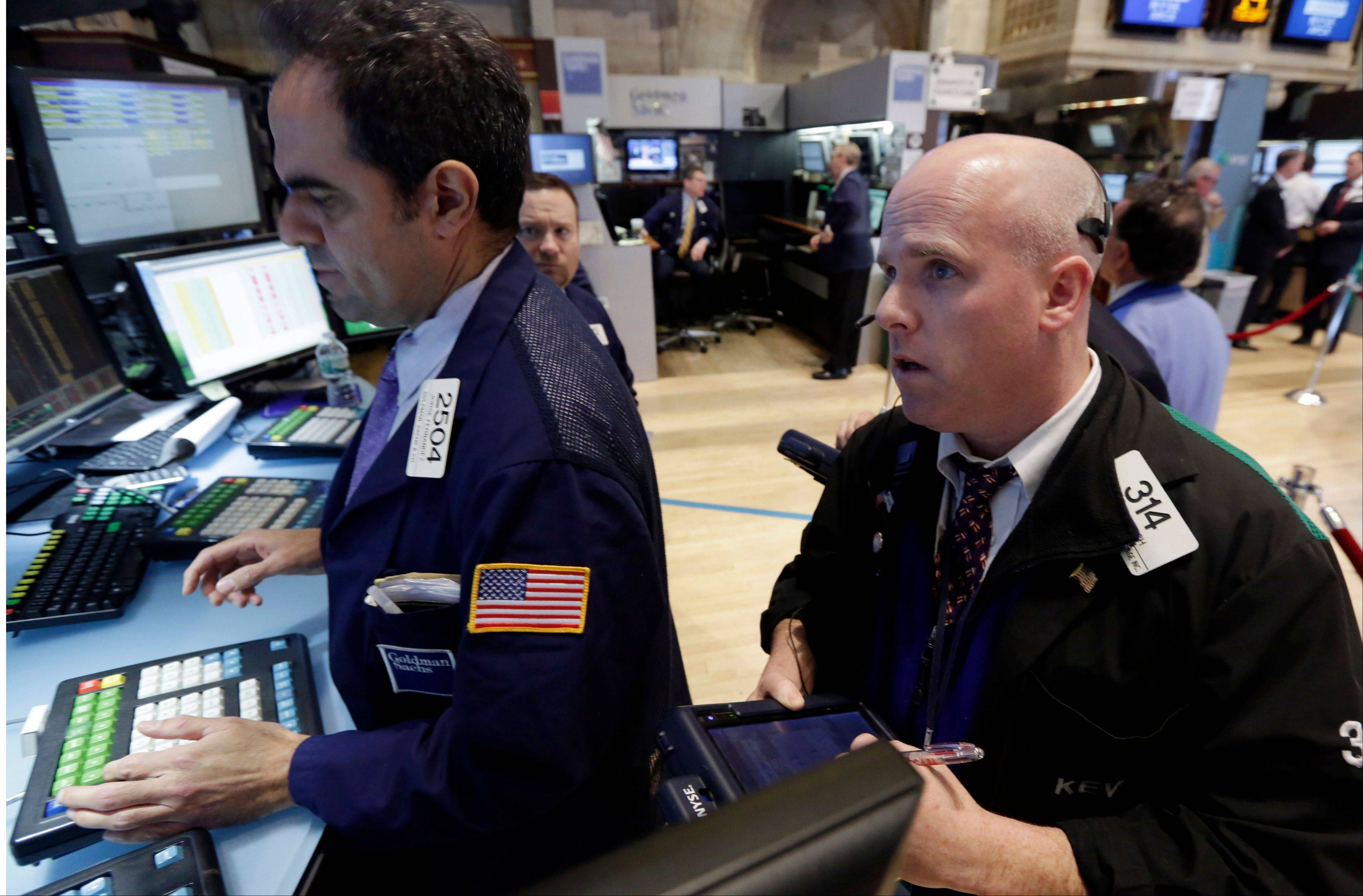U.S. stocks rose Wednesday, with the Standard & Poor's 500 Index erasing a loss for 2014 to close at a record, as the World Bank lifted its global growth forecast and Bank of America Corp.'s profit spurred a rally in financial shares.