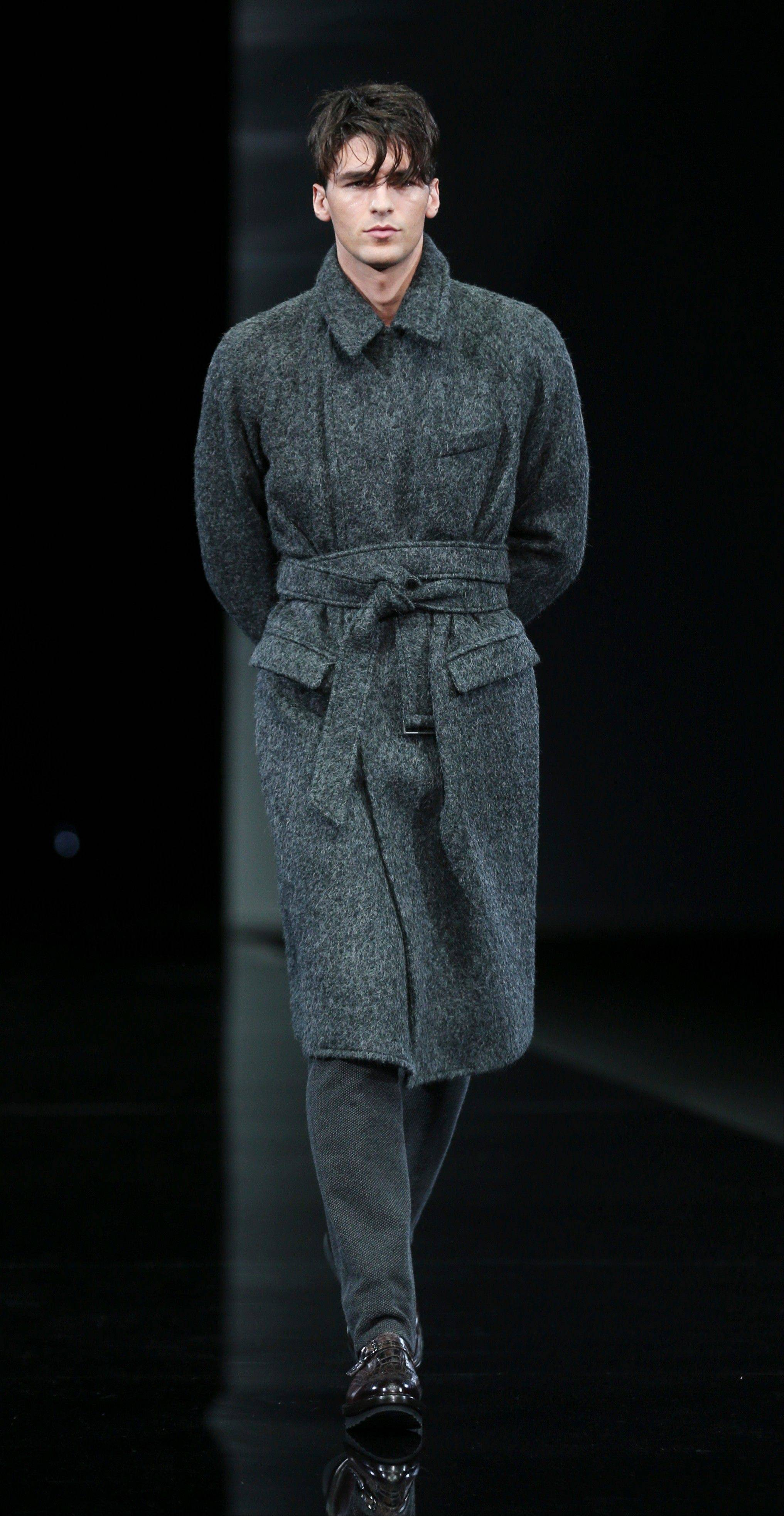 A model wears a creation for Giorgio Armani men's Fall-Winter 2014 collection, part of the Milan Fashion Week, unveiled in Milan, Italy, Tuesday.